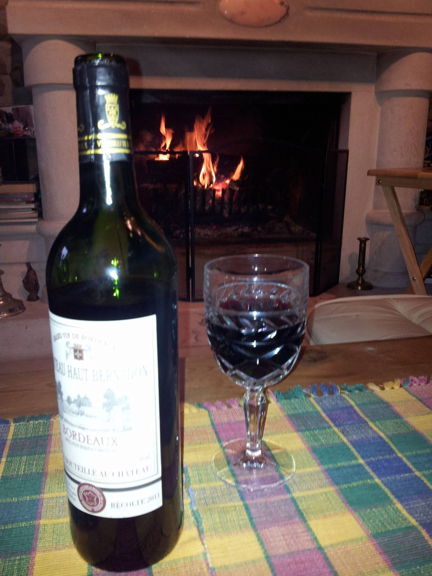 red wine by an open fire