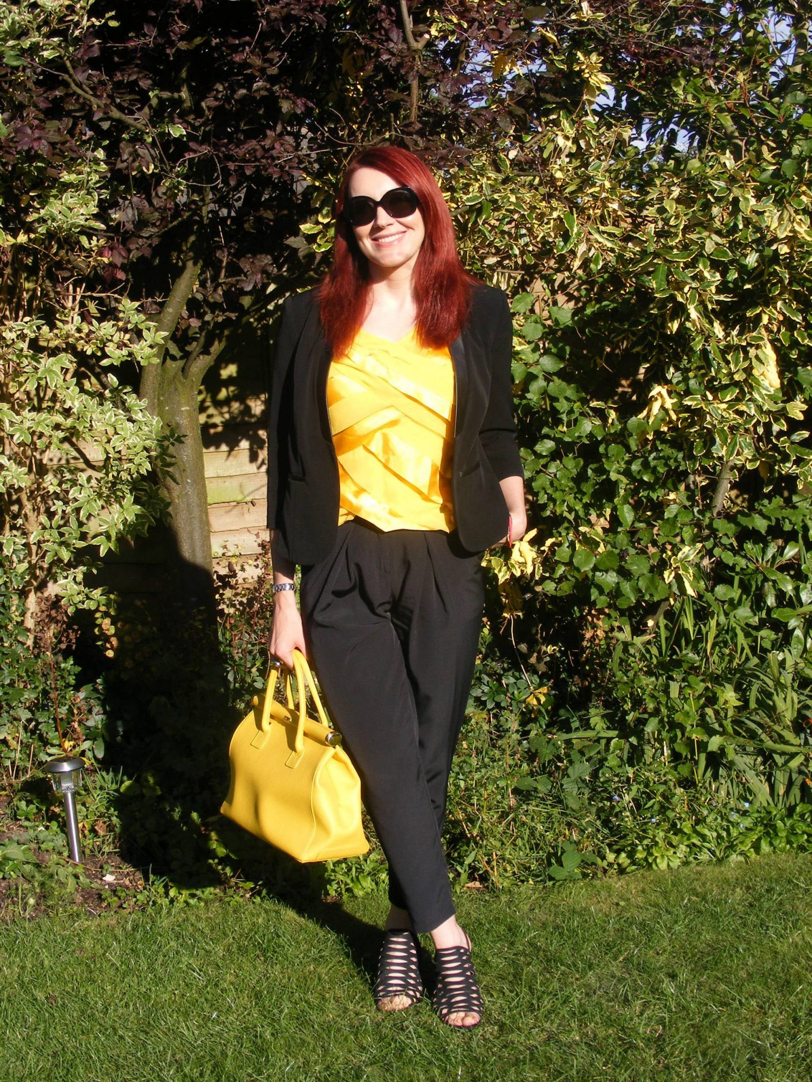 Sunflowers black M&S jacket yellow top
