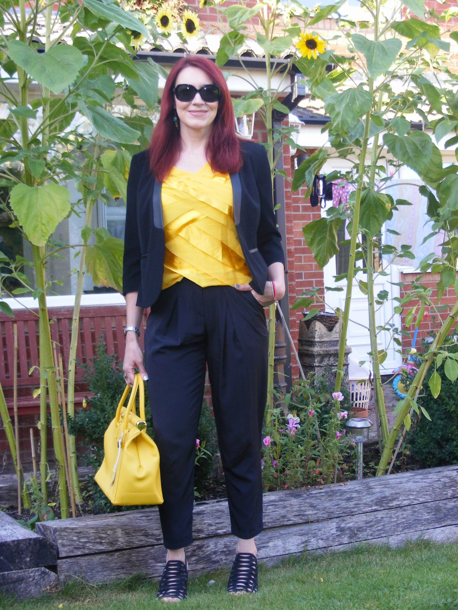 Sunflowers, black M&S jacket, yellow Principles by Ben de Lisi top