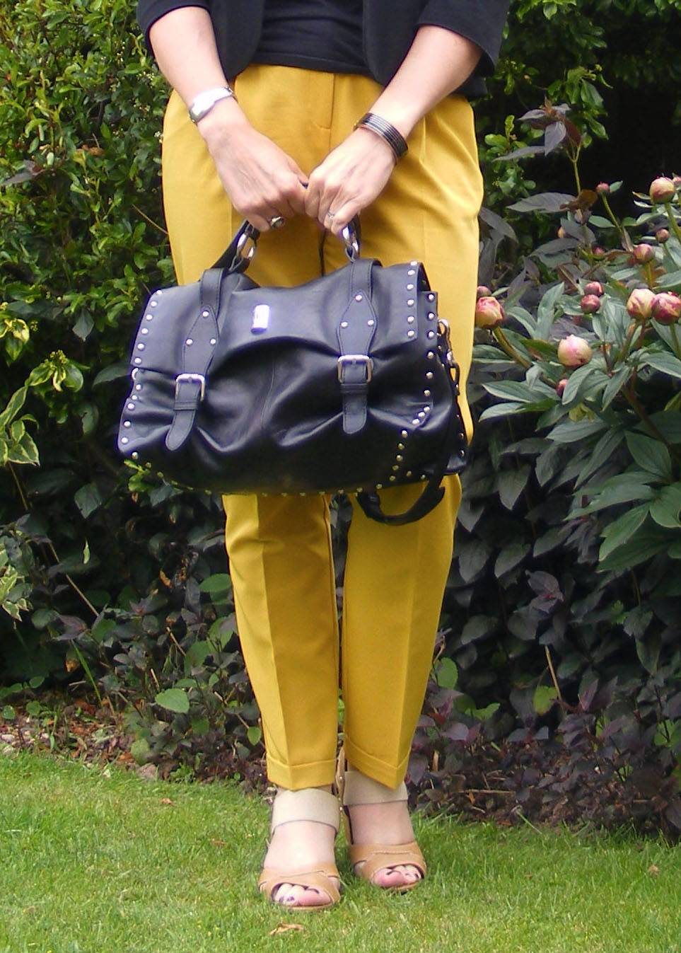 Asos mustard trousers and black modalu bag