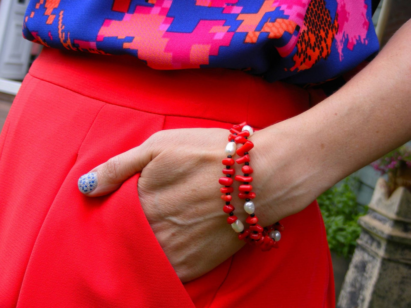 Marks and Spencer red skirt and Pia coral bracelet