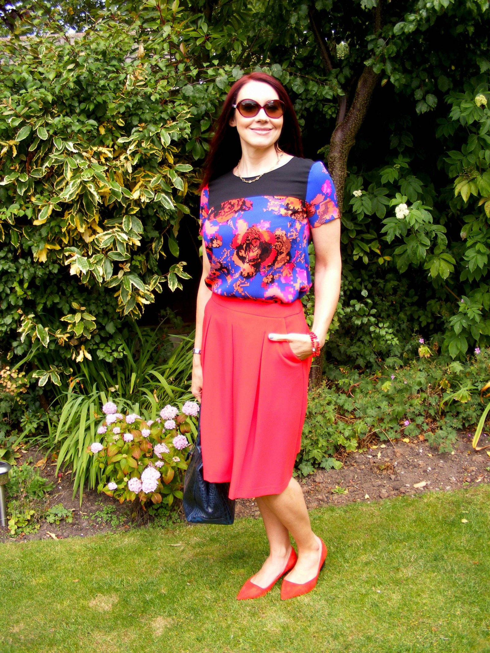 M&S pixel print top and red Buttonsafe skirt