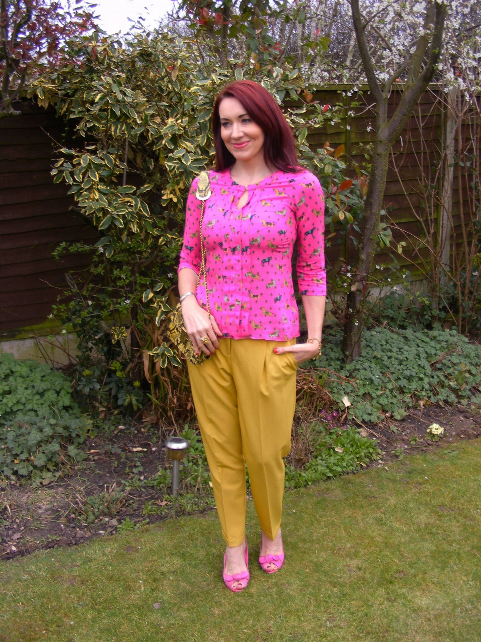 Asos mustard trousers pink horse print blouse Angel Jackson bag