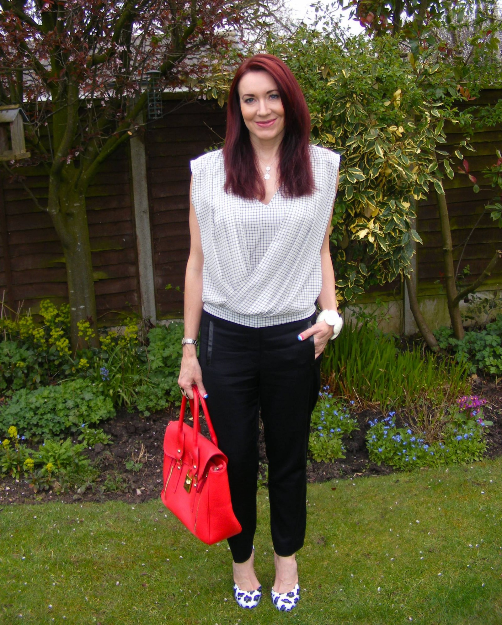 Warehouse check top Tibi black trousers Kurt Geiger white leopard print shoes