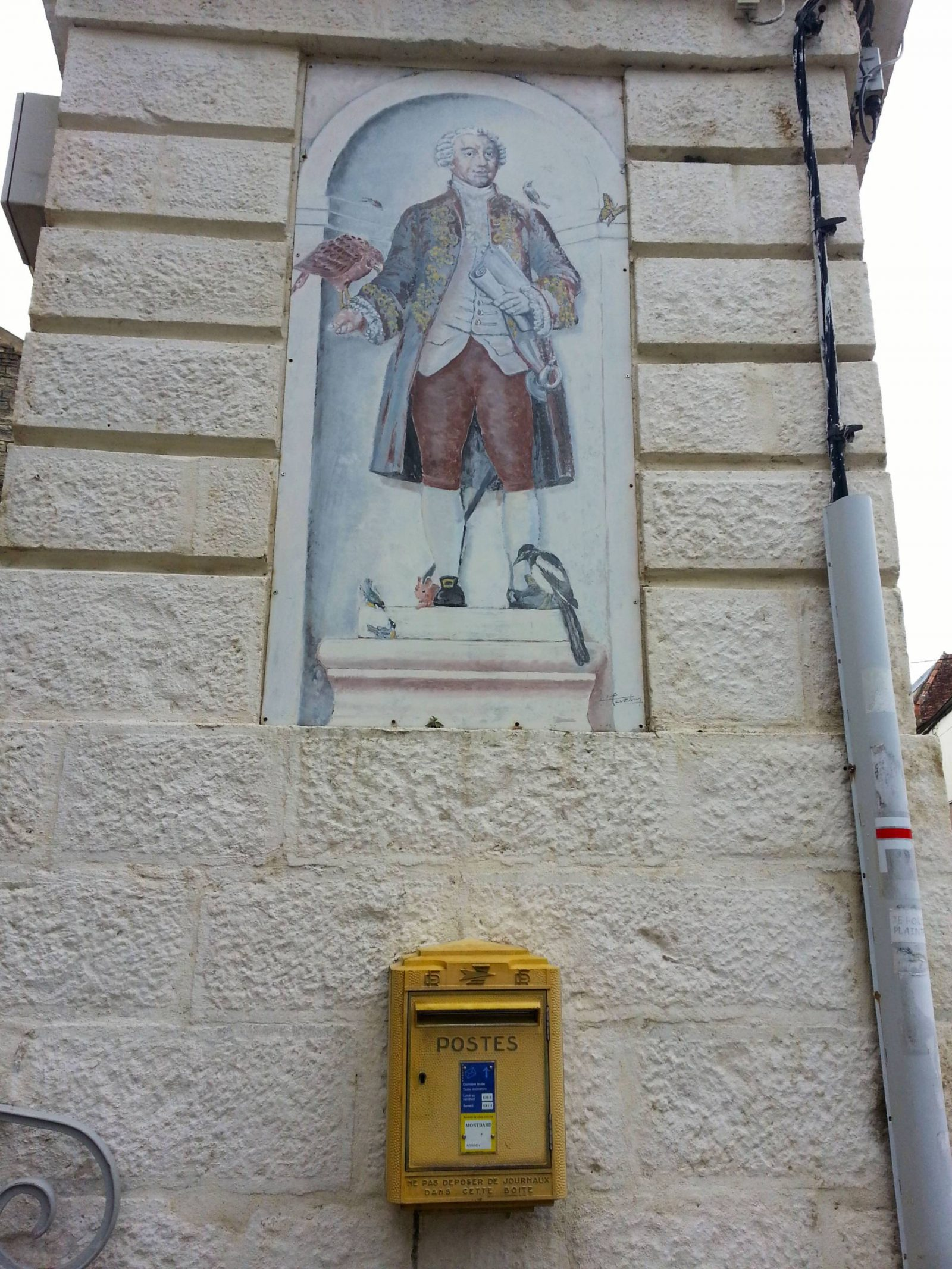 post box and mural in Avallon