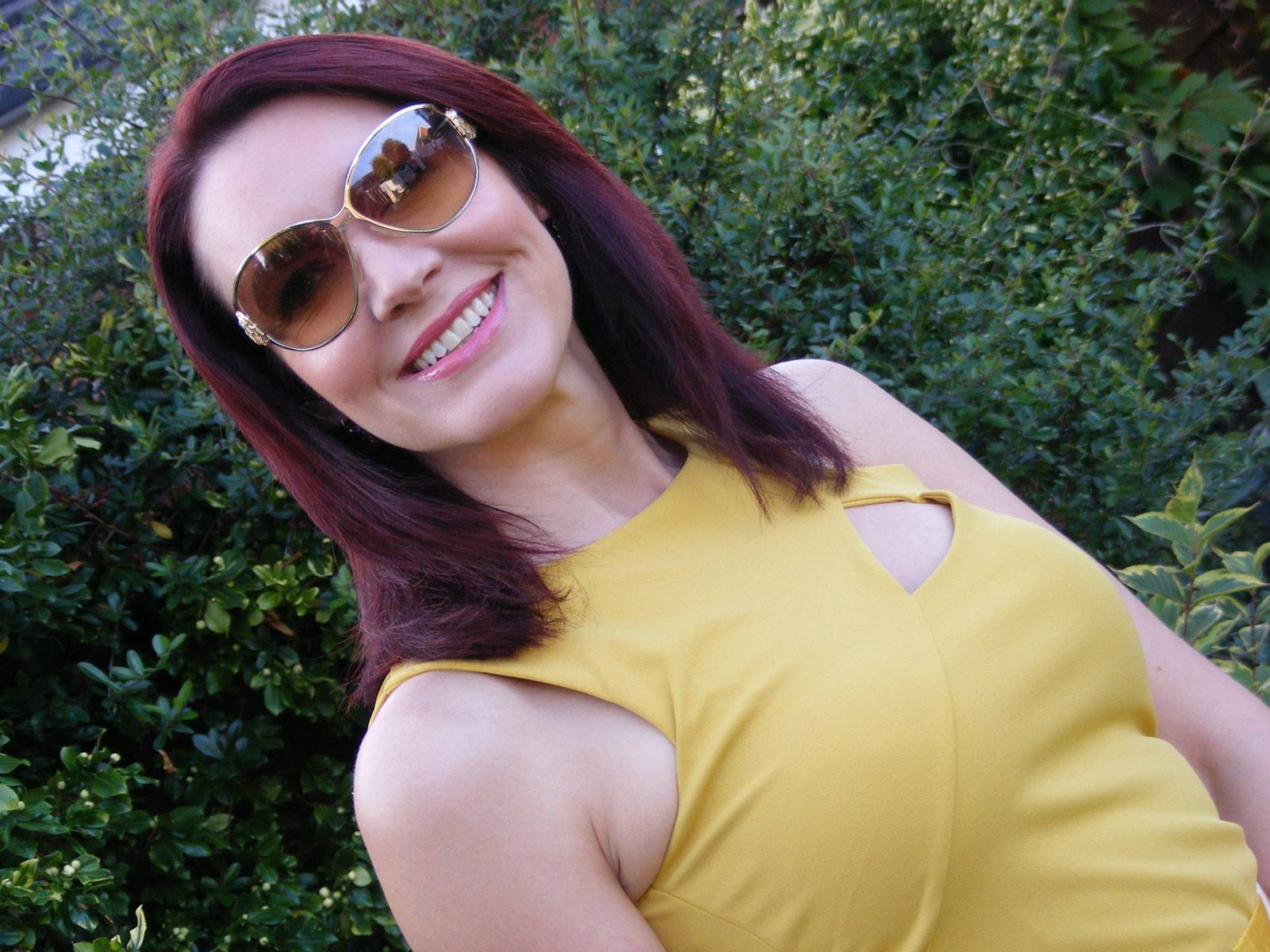 Jane Norman yellow top Roberto Cavalli sunglasses