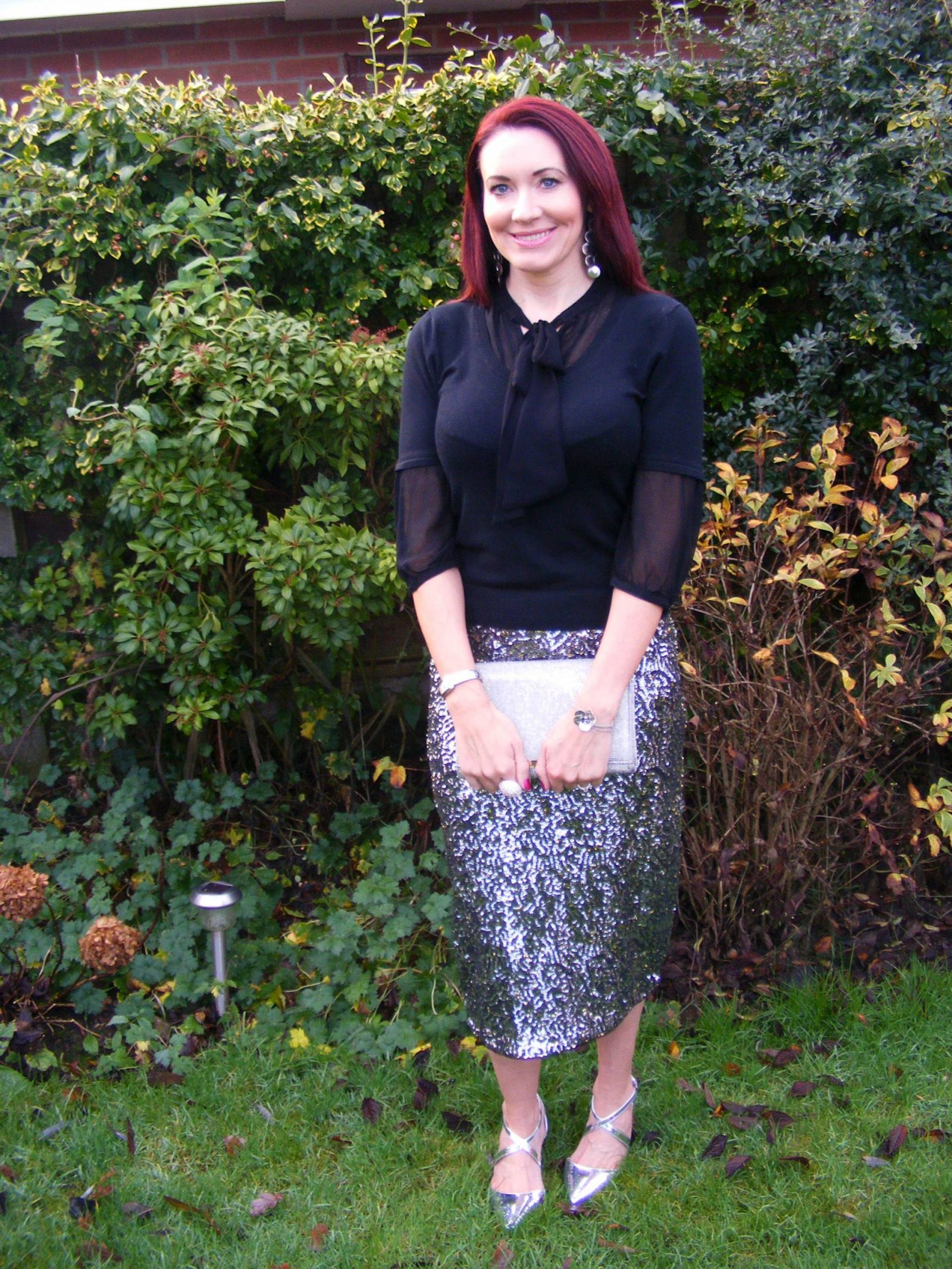 Sequins and Glitter | How to add a little sparkle to your festive outfit Oasis sequin skirt Matalan glitter clutch Carvela silver shoes