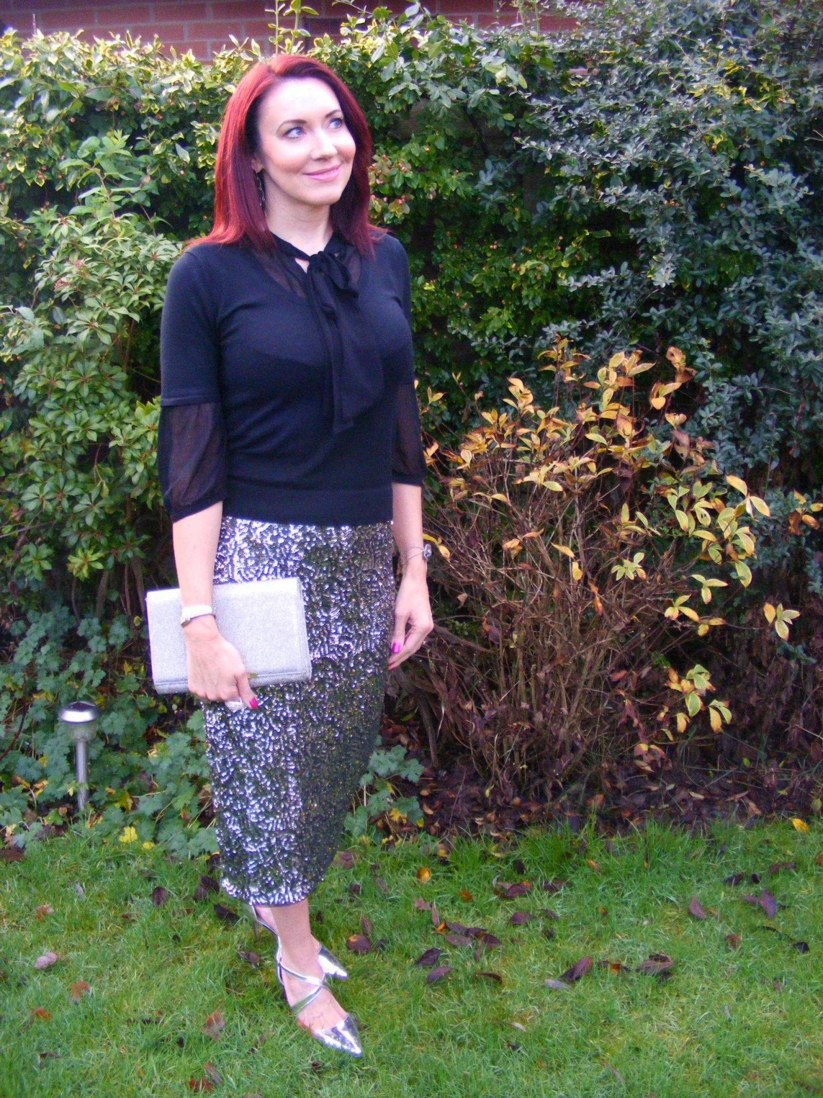 Sequins and Glitter | How to add a little sparkle to your festive outfit Oasis sequin skirt Matalan glitter clutch