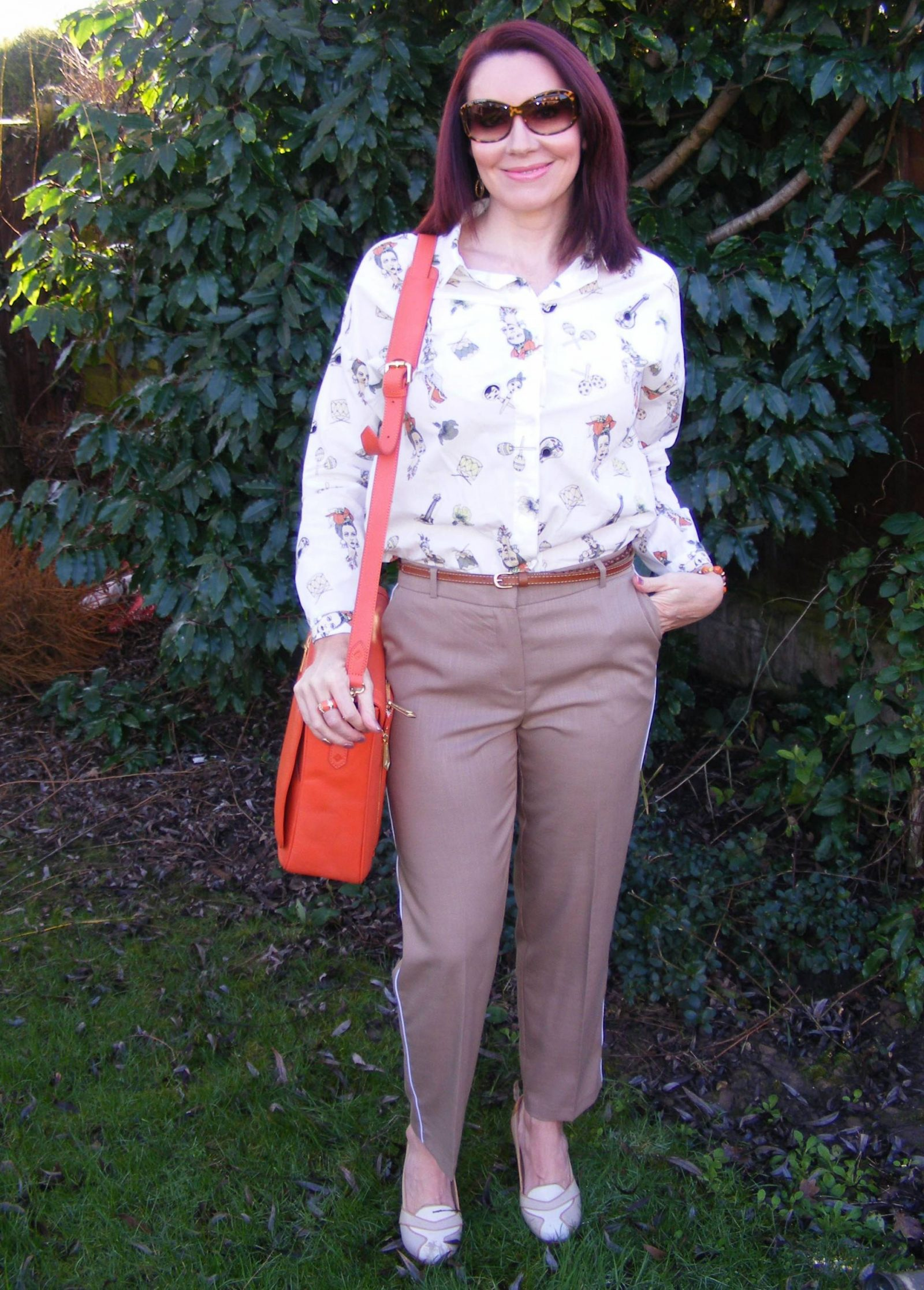 Neutrals With a Pop of Orange Zara shirt Model KT bag Asos trousers