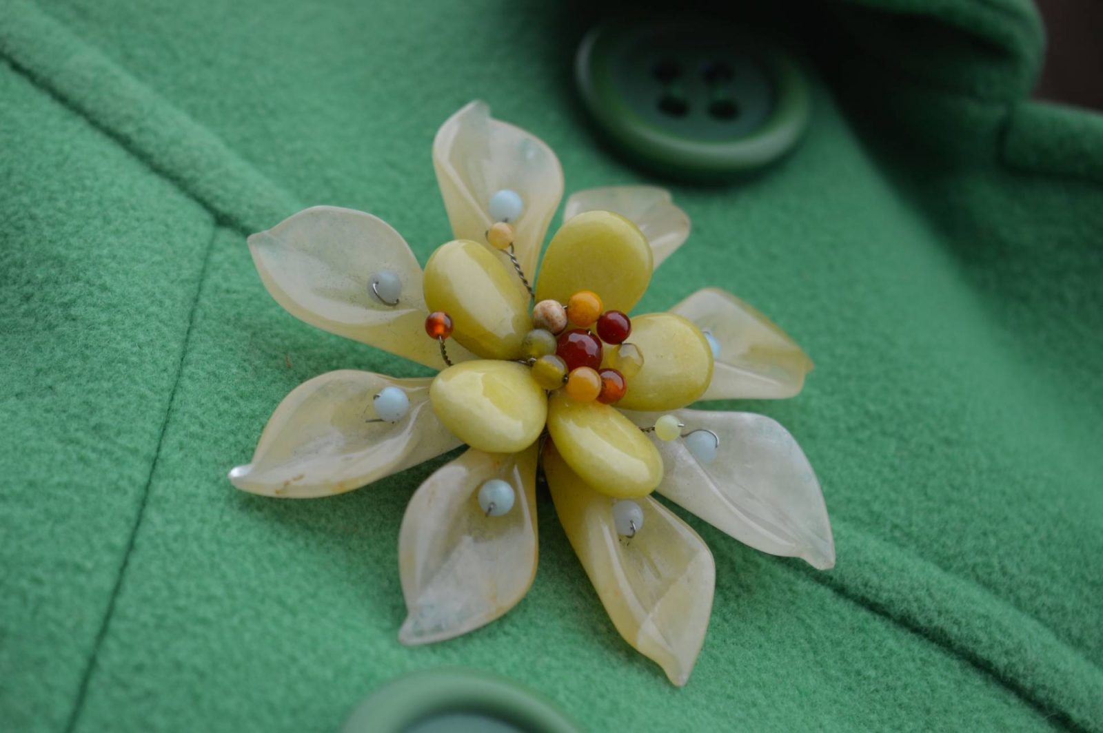 Shades of Green and Brown Laura Ashley green coat Pia flower-brooch