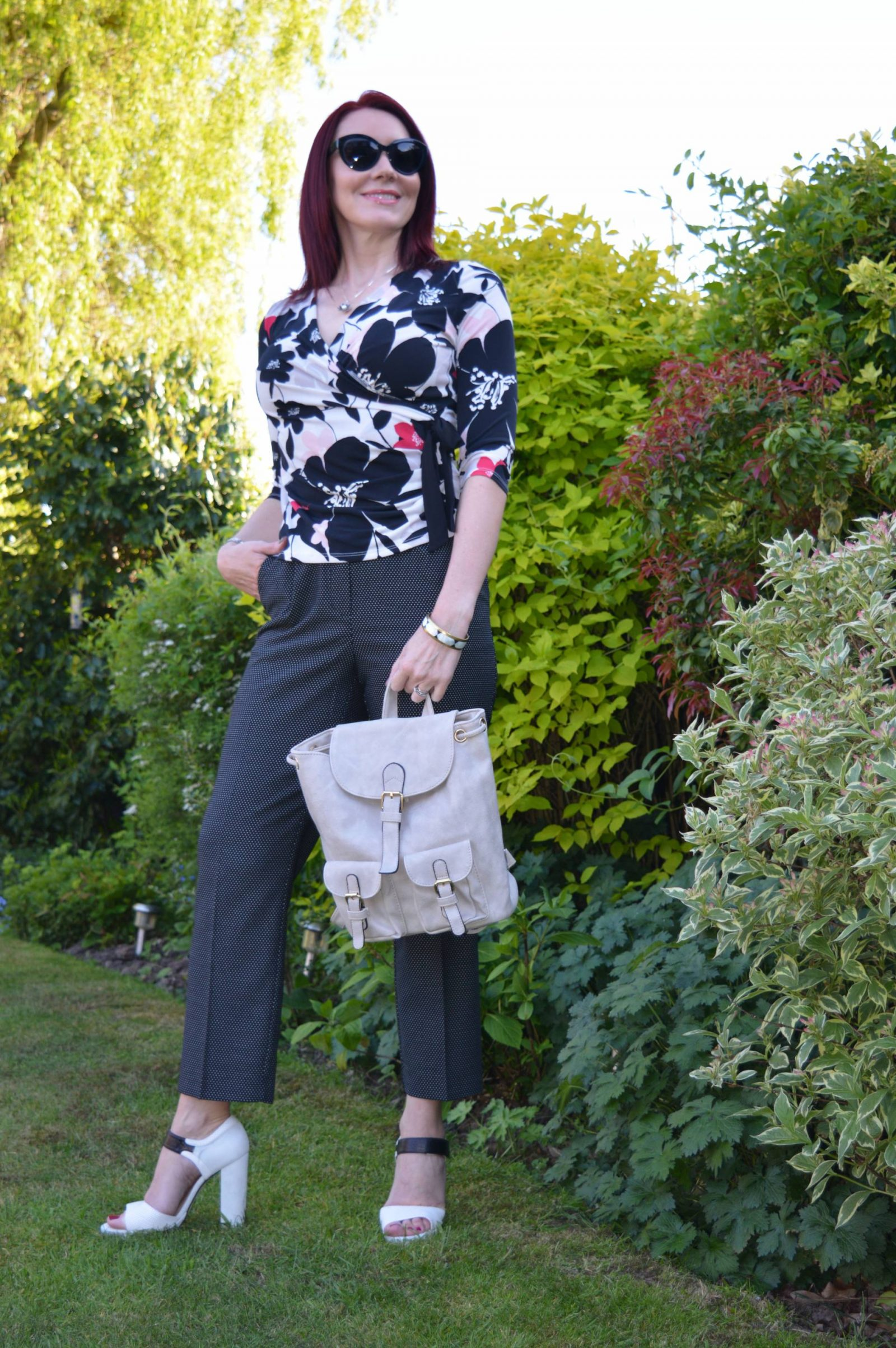 pattern mixing with floral print and spots Ooh accessories backpack