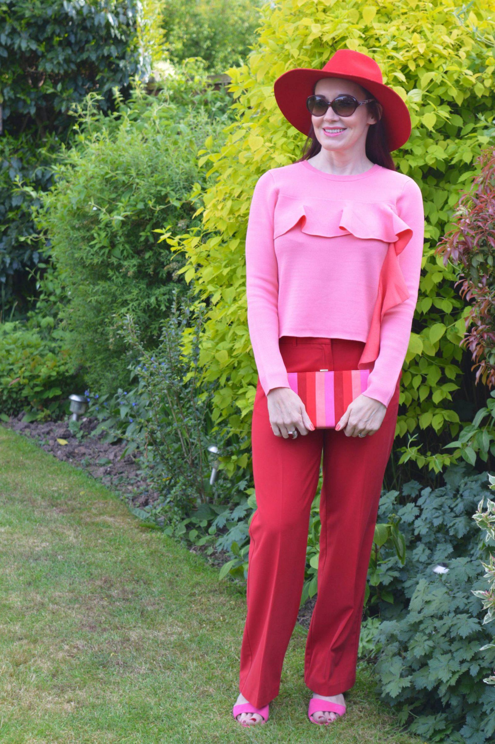 Red oasis trousers, Lotus shoes and bag Asos pink ruffle jumper