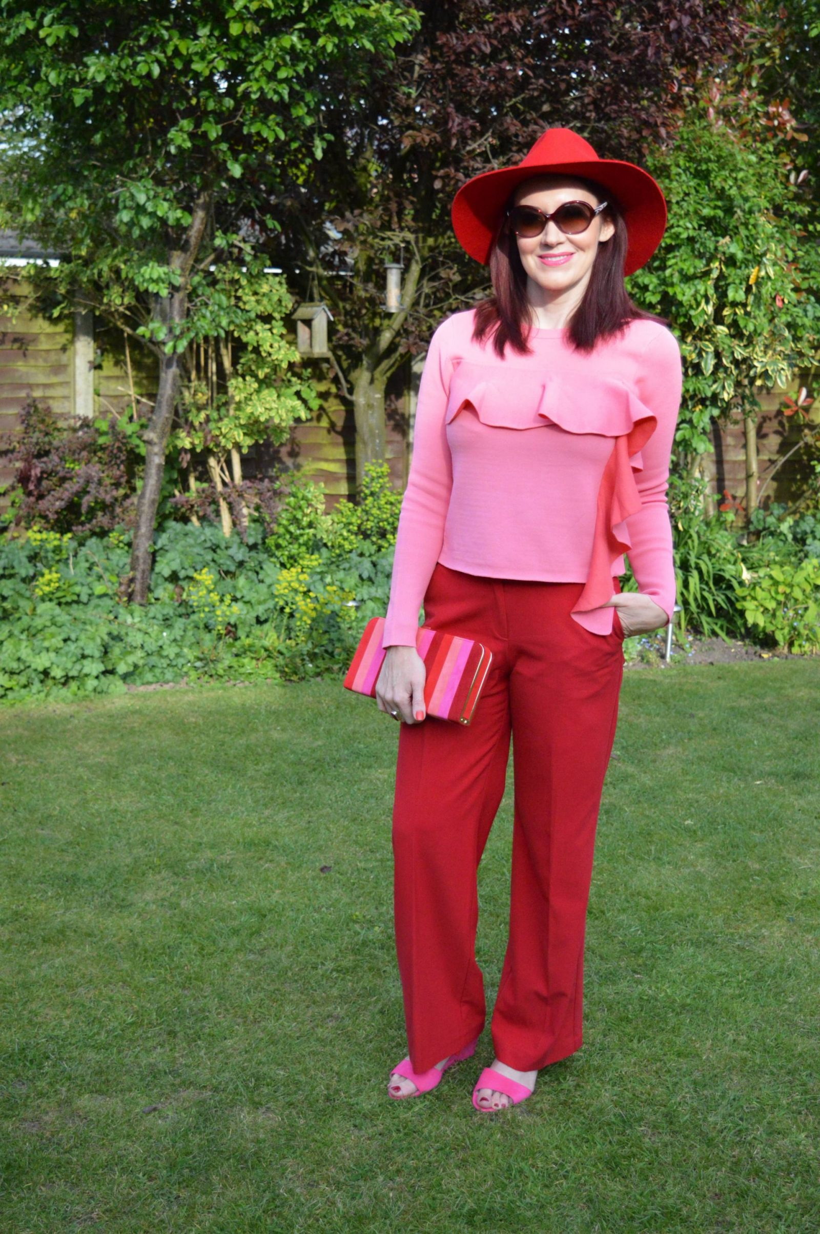 Colour blocking red and pink with lotus shoes and bag Red and pink colour combination