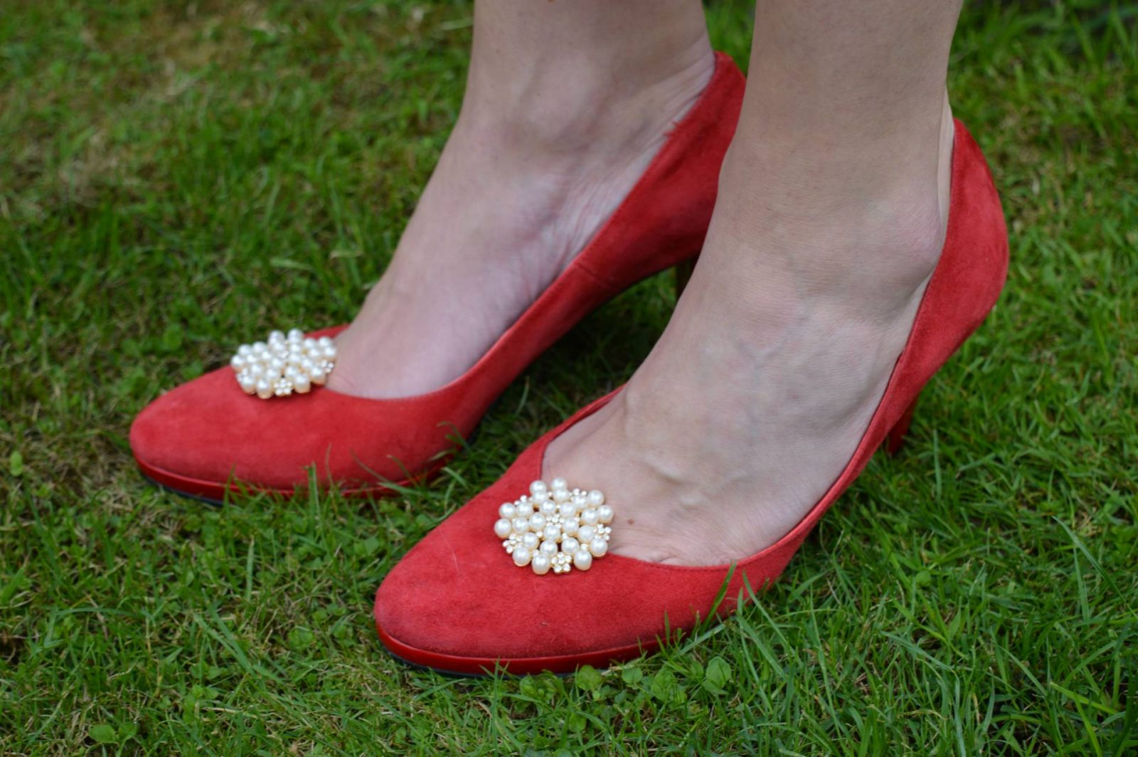 red suede shoes with shoe clips