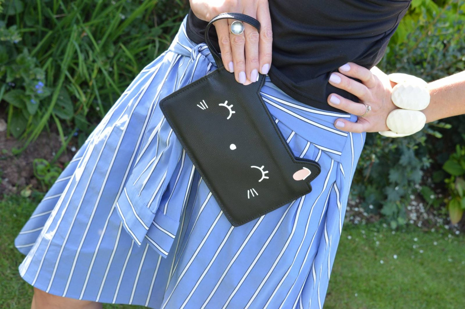 A Skirt With Sleeves Zara midi skirt Prezzybox Kitty clutch