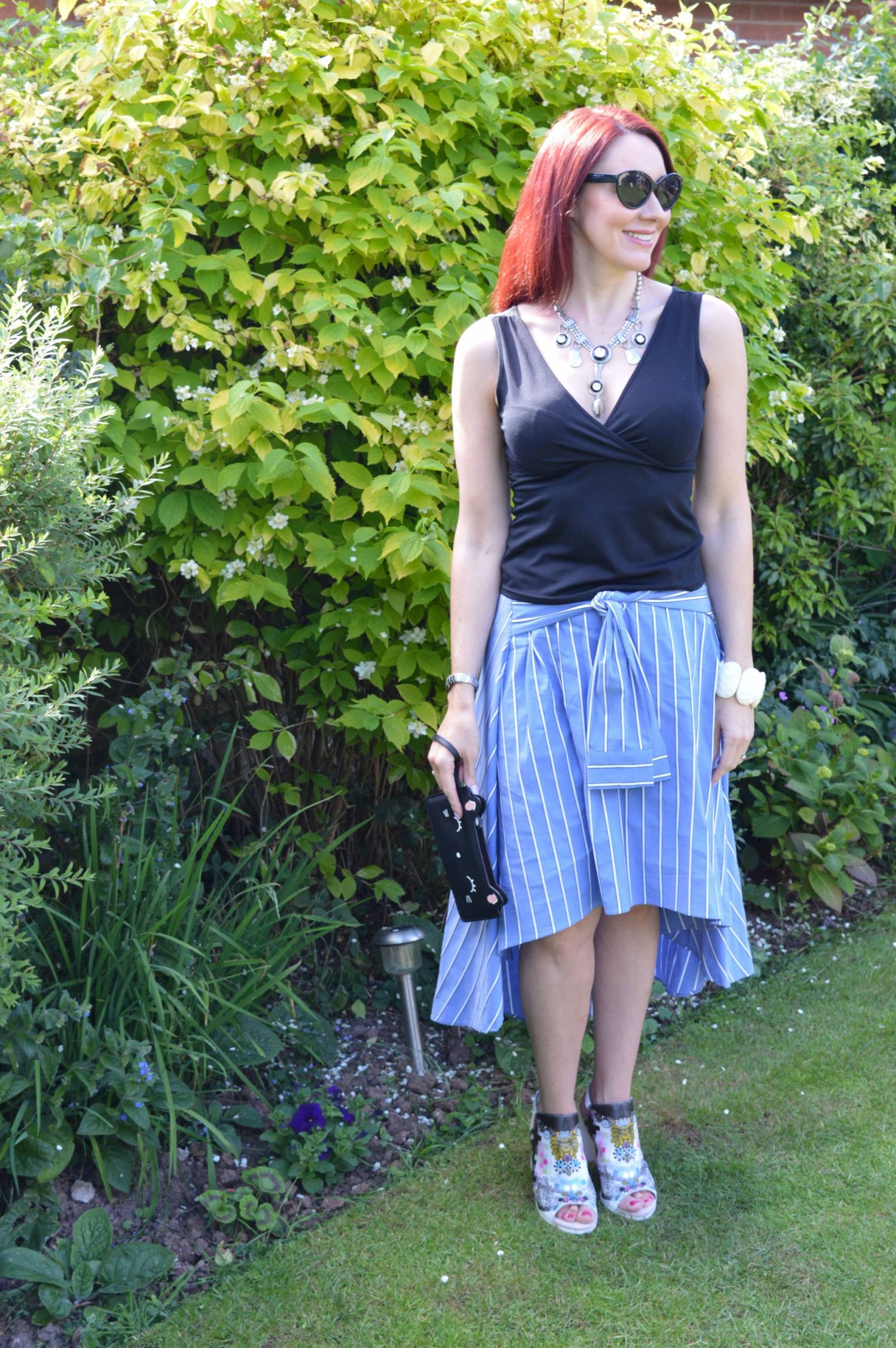 A Skirt With Sleeves Zara midi skirt Prezzybox Kitty clutch Aldo Rise shoes
