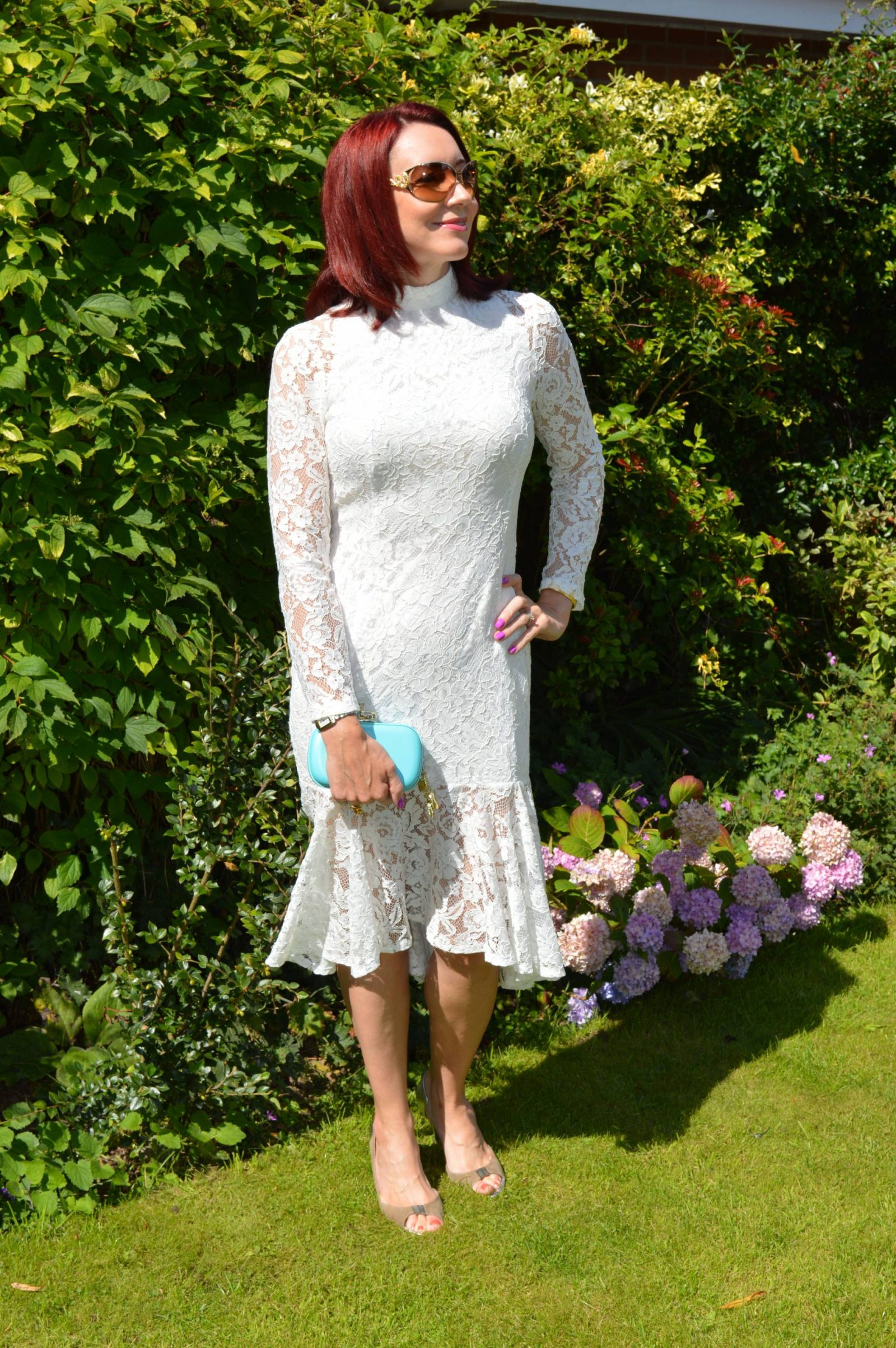 Wedding Guest Dresses From PrettyLittleThing Ellina white lace fishtail dress Anna Dello Russo H&M clutch bag