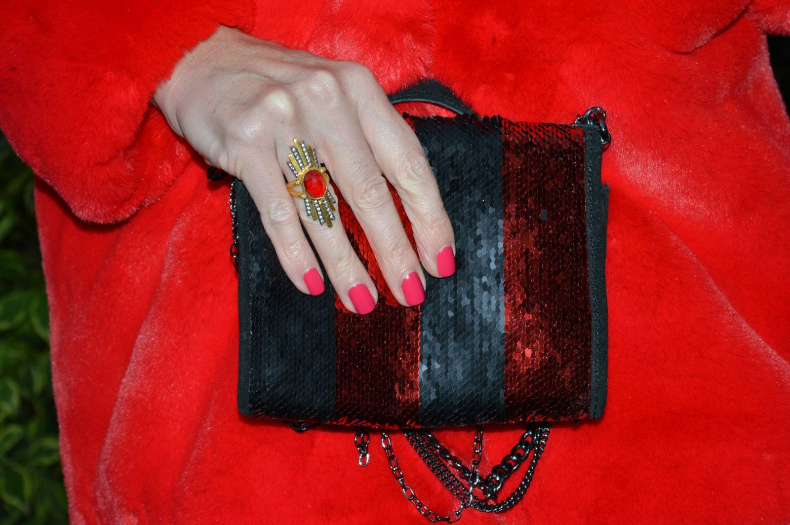 Red faux fur coat and black coated jeans Zara black and red sequin bag