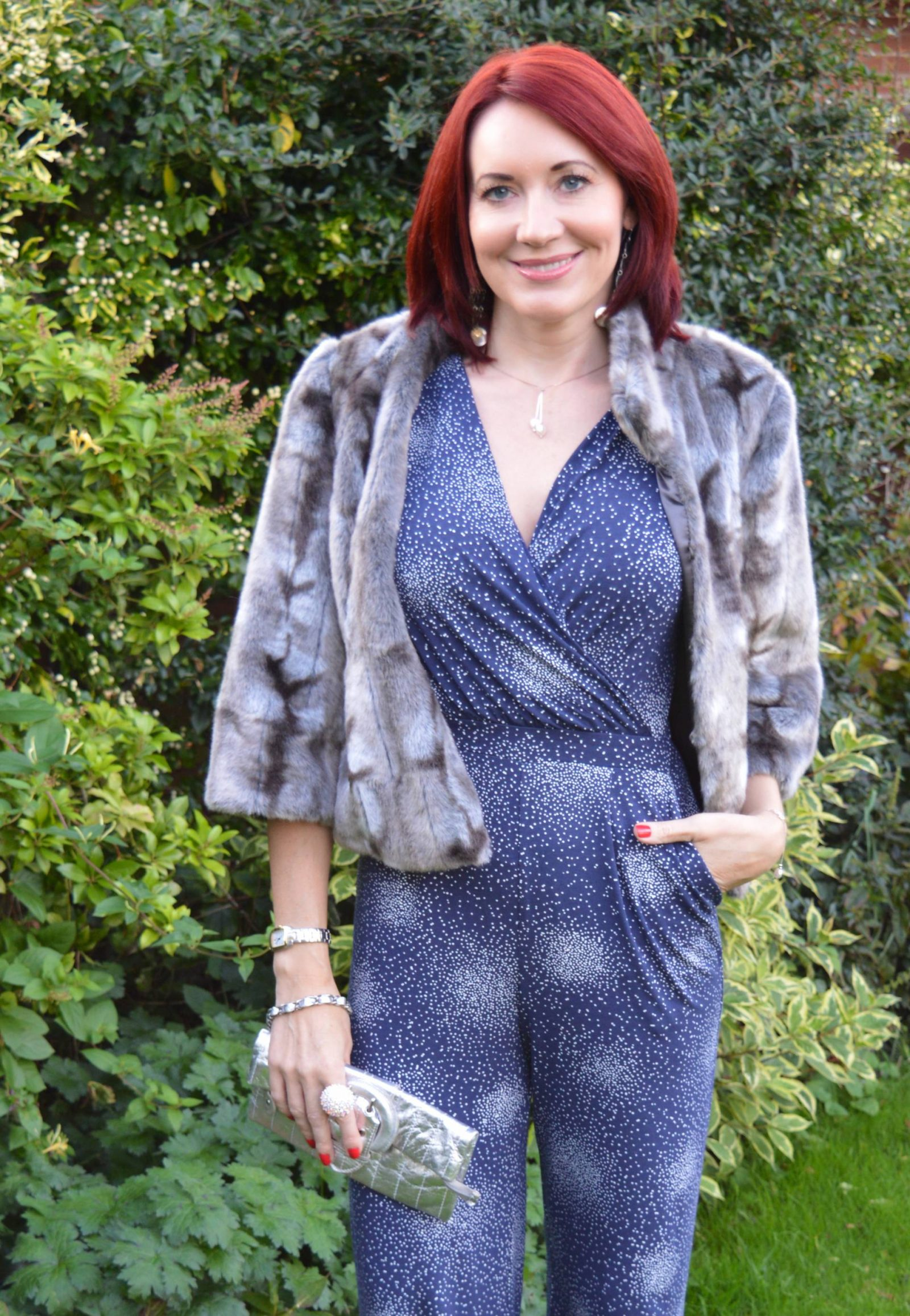 Styling a jumpsuit for day to night Laura Ashley navy jumpsuit matalan silver sandals Per Una faux fur grey jacket