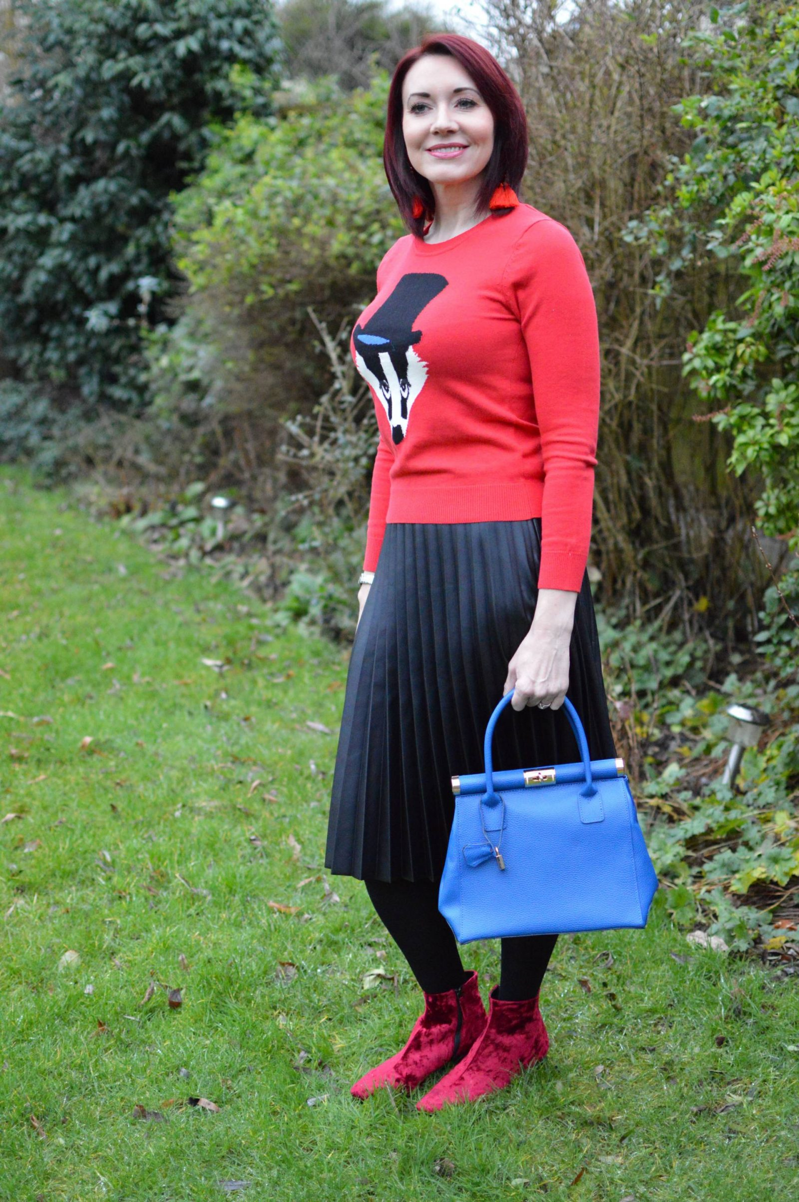 Faux Leather Pleated Skirt and Badger Jumper