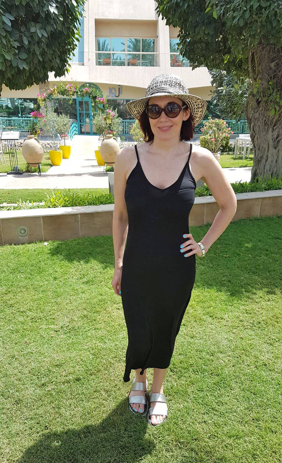 Poolside Glamour With Miss Tunica, black slip dress, Mango straw fedora