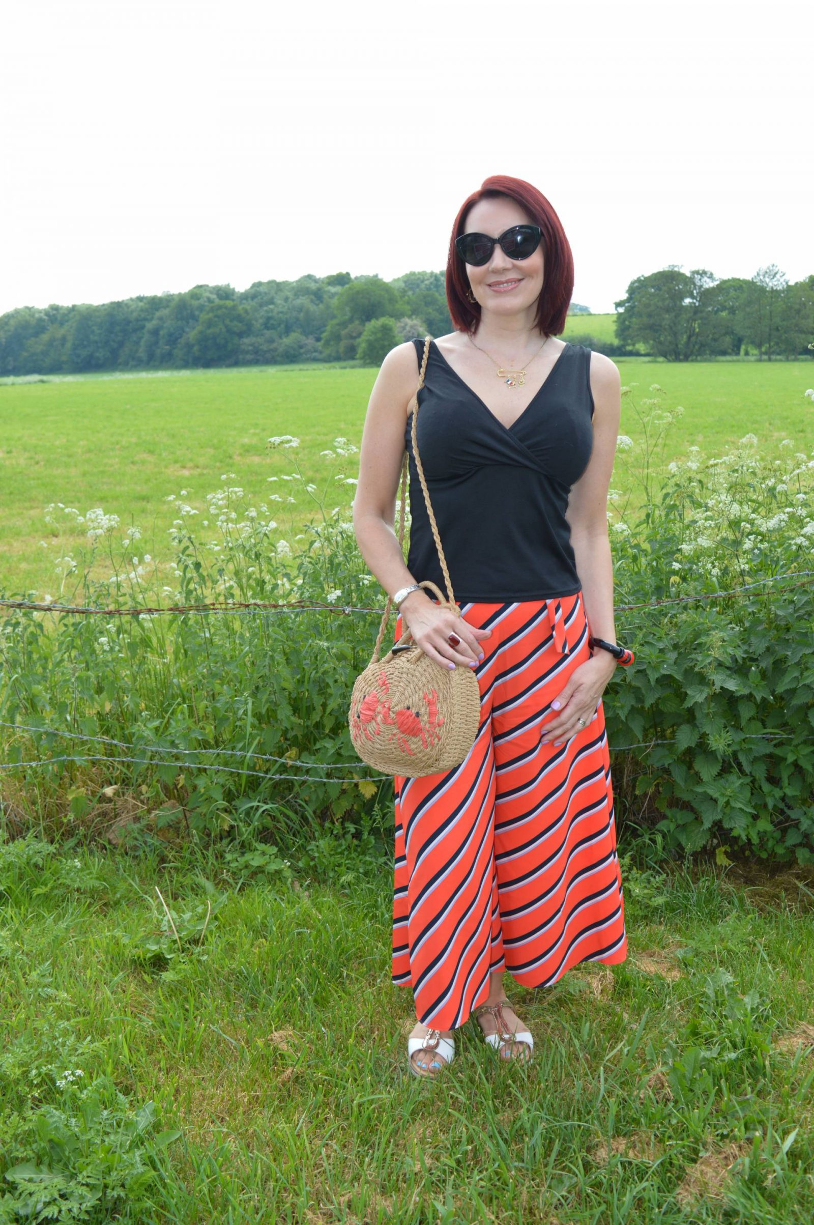 Bershka Diagonal striped wide leg trousers and Topshop crab straw bag
