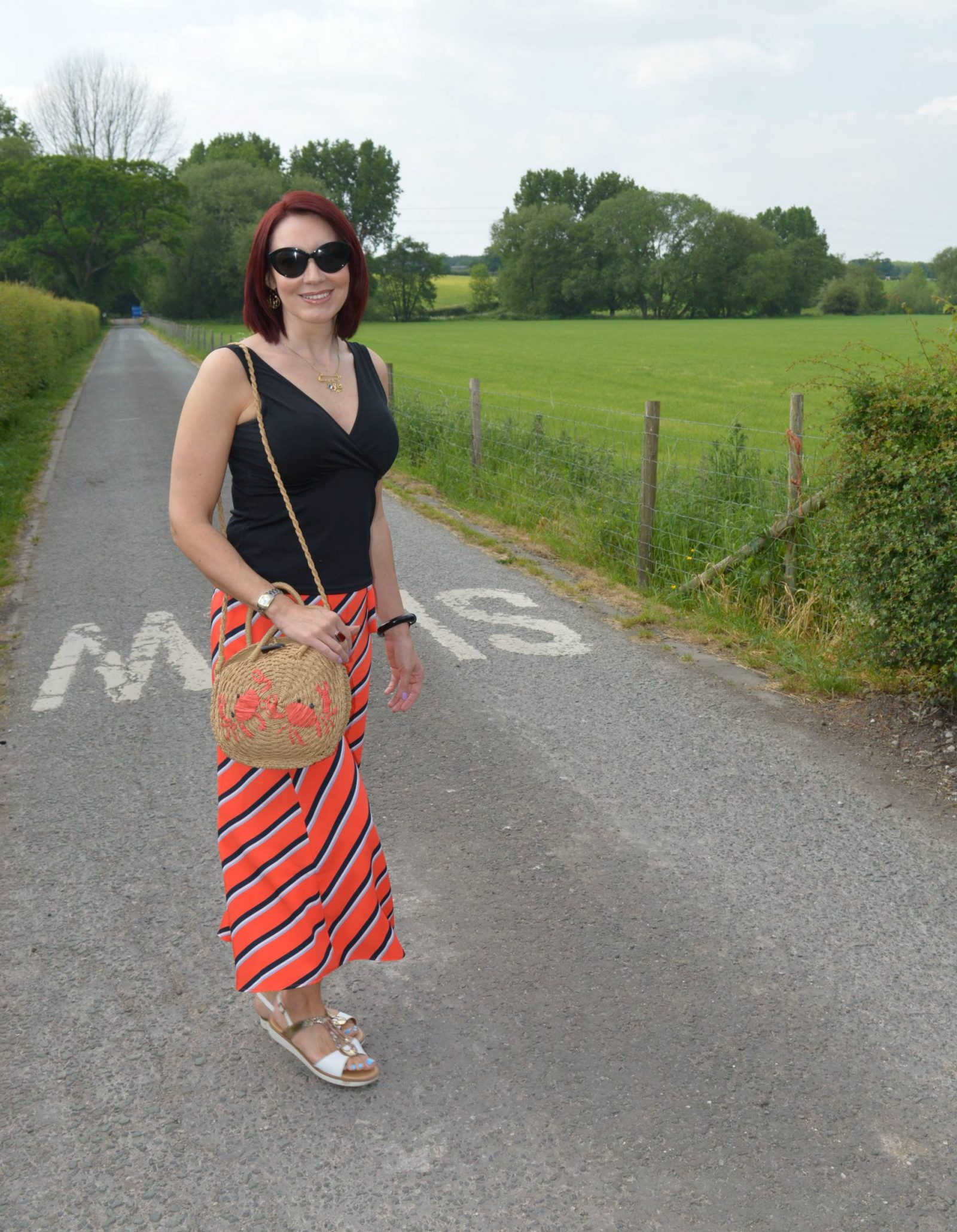 Diagonal striped wide leg trousers and crab straw bag
