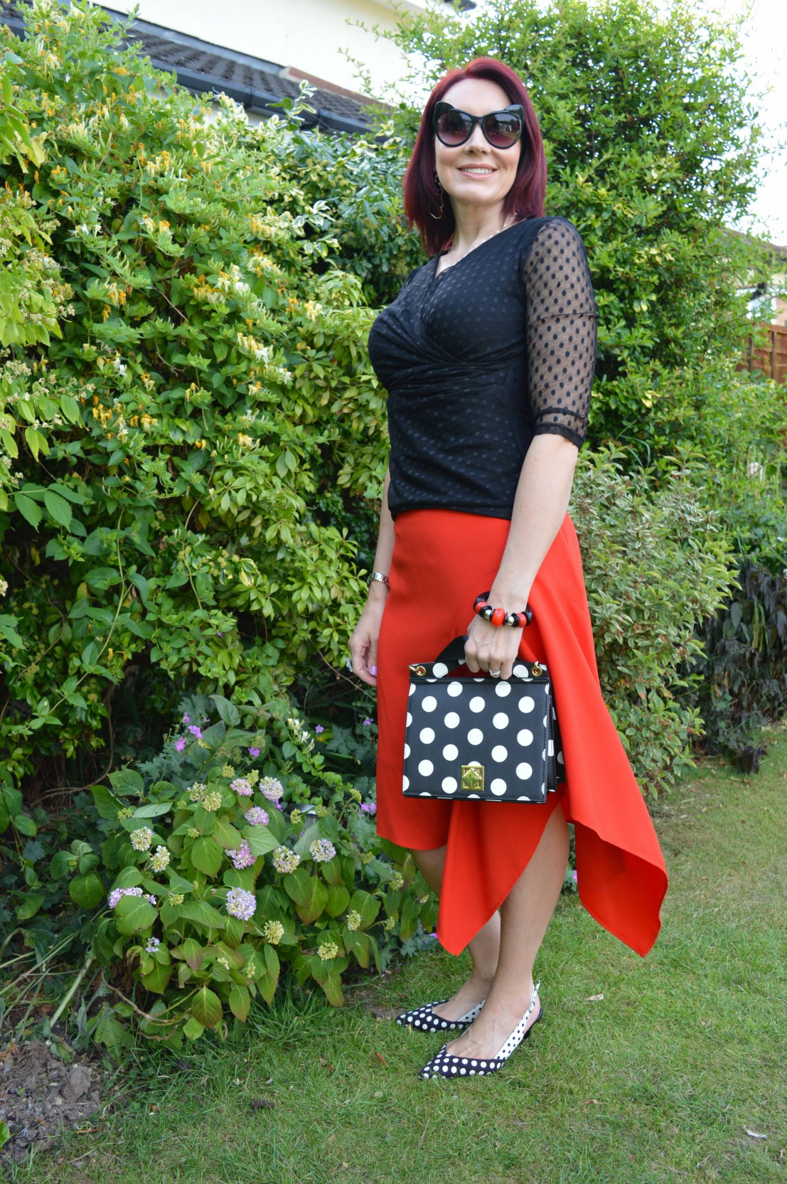 Black and white polka dots with an asymmetric skirt