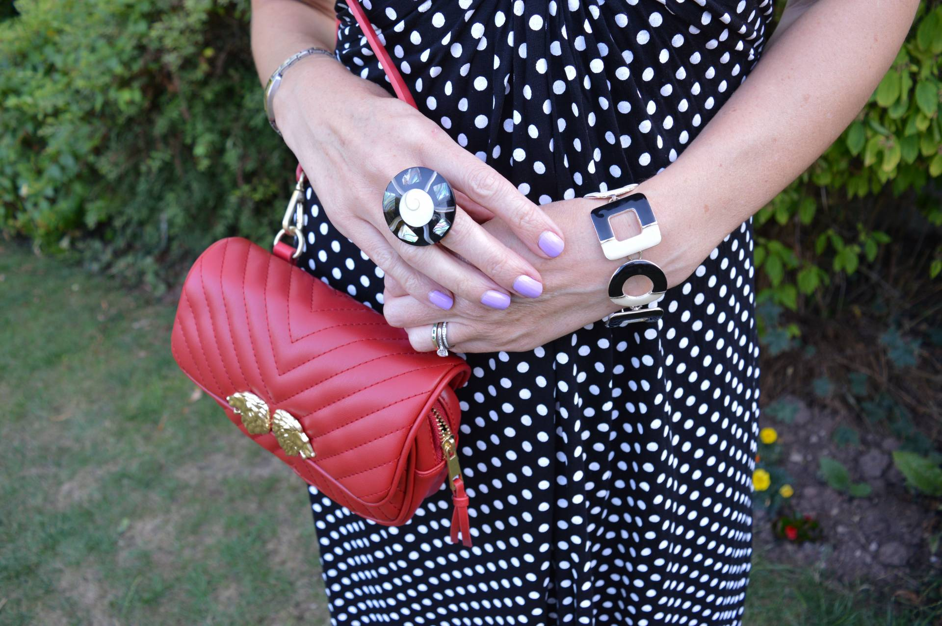 Black and white polka dot dress with red accessories + link up