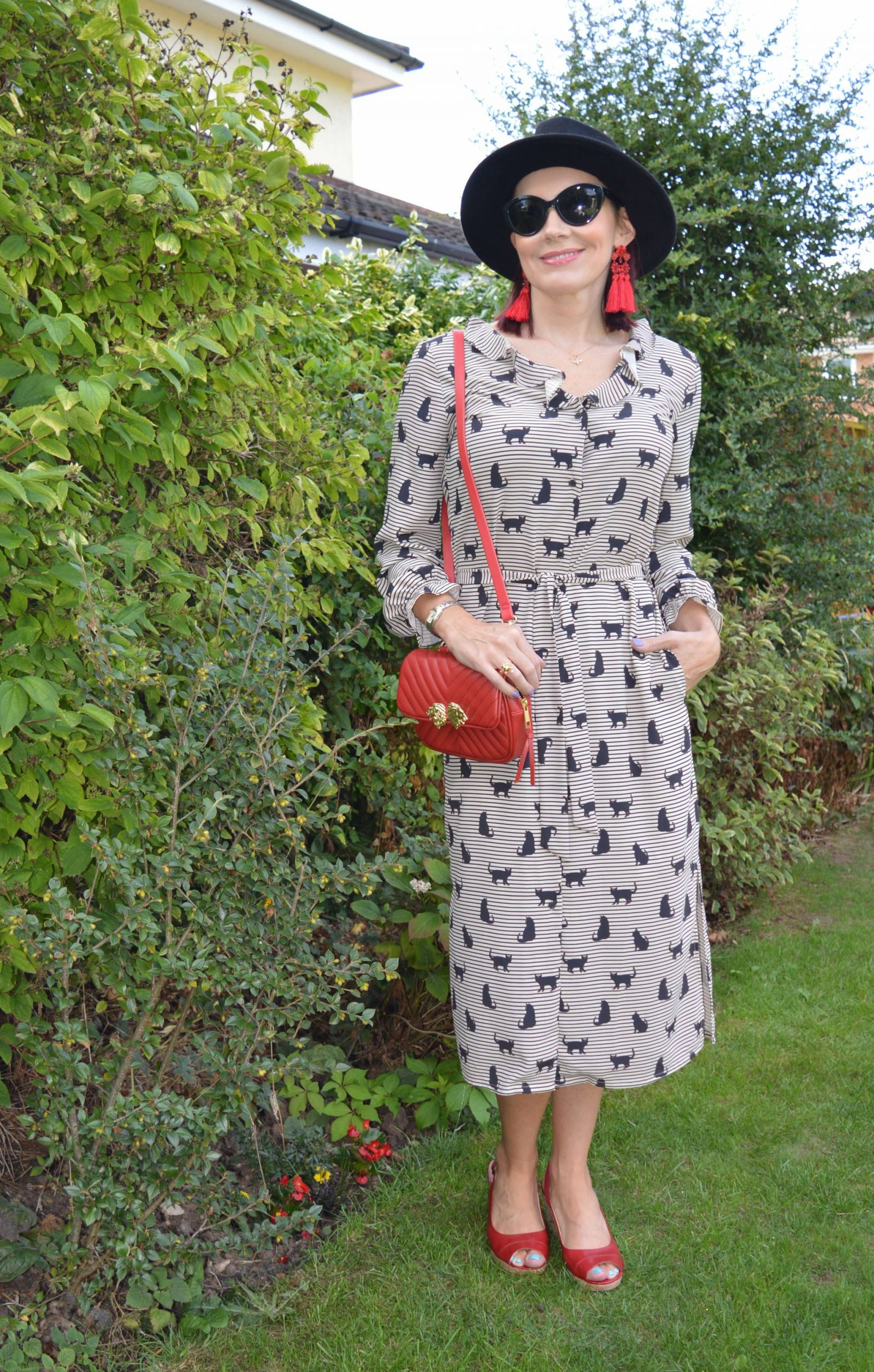 Cat print shirt dress with red accessories