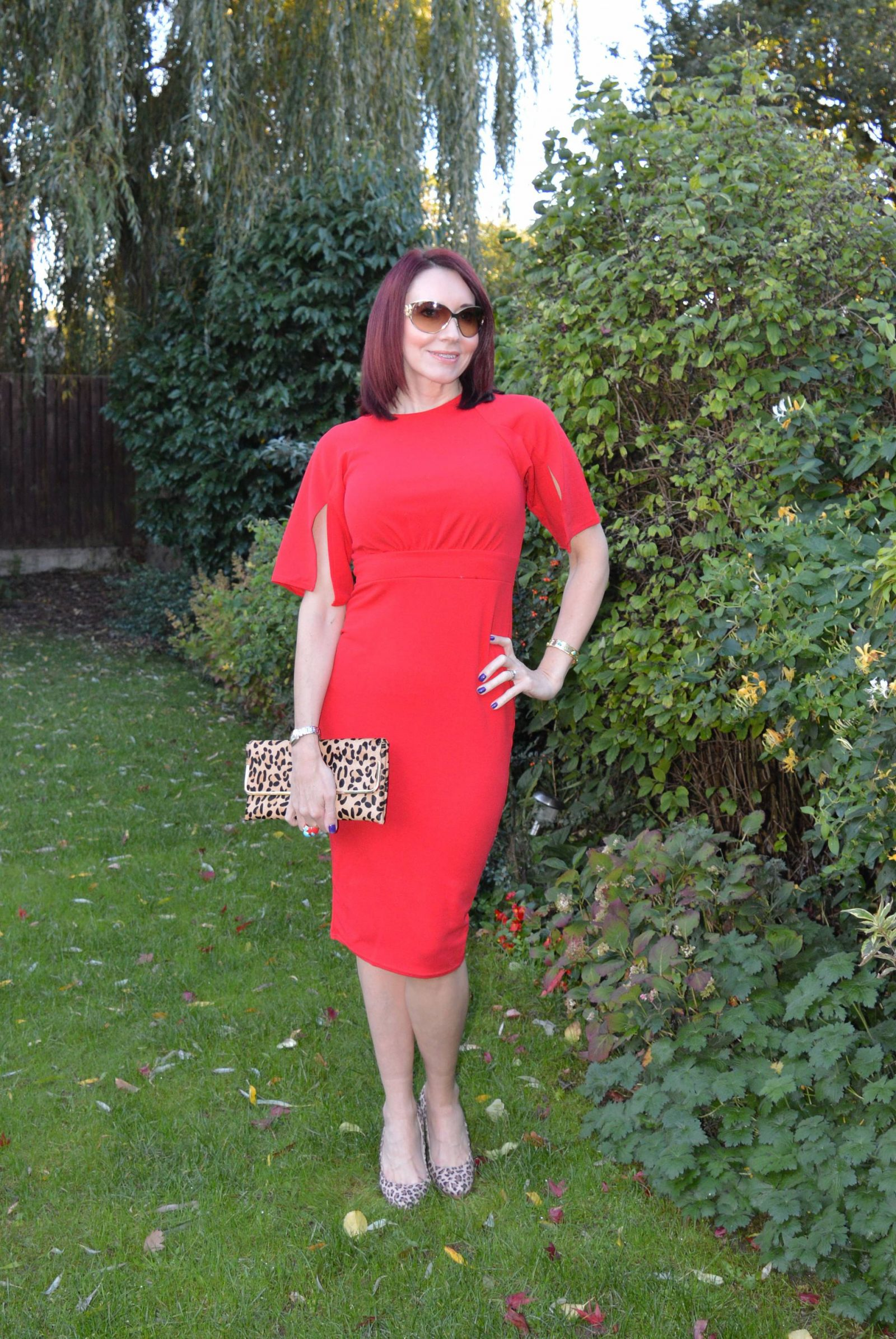 Red dress with leopard print accessories
