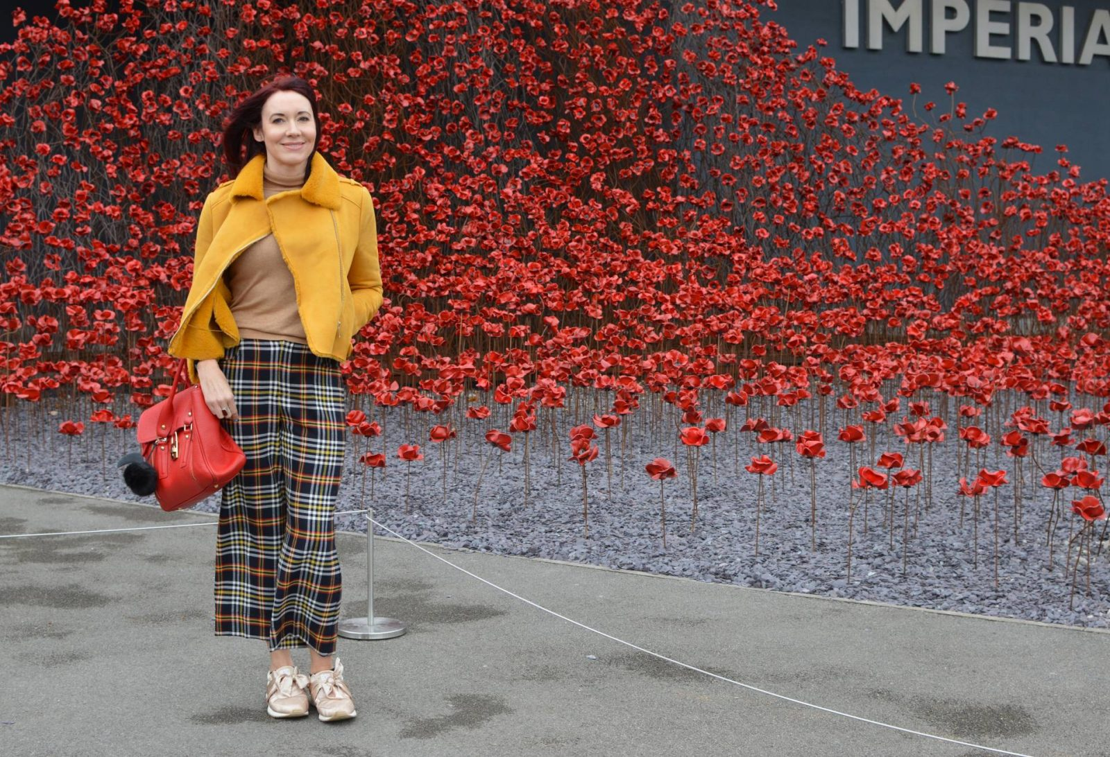 Mustard bomber jacket and tartan trousers