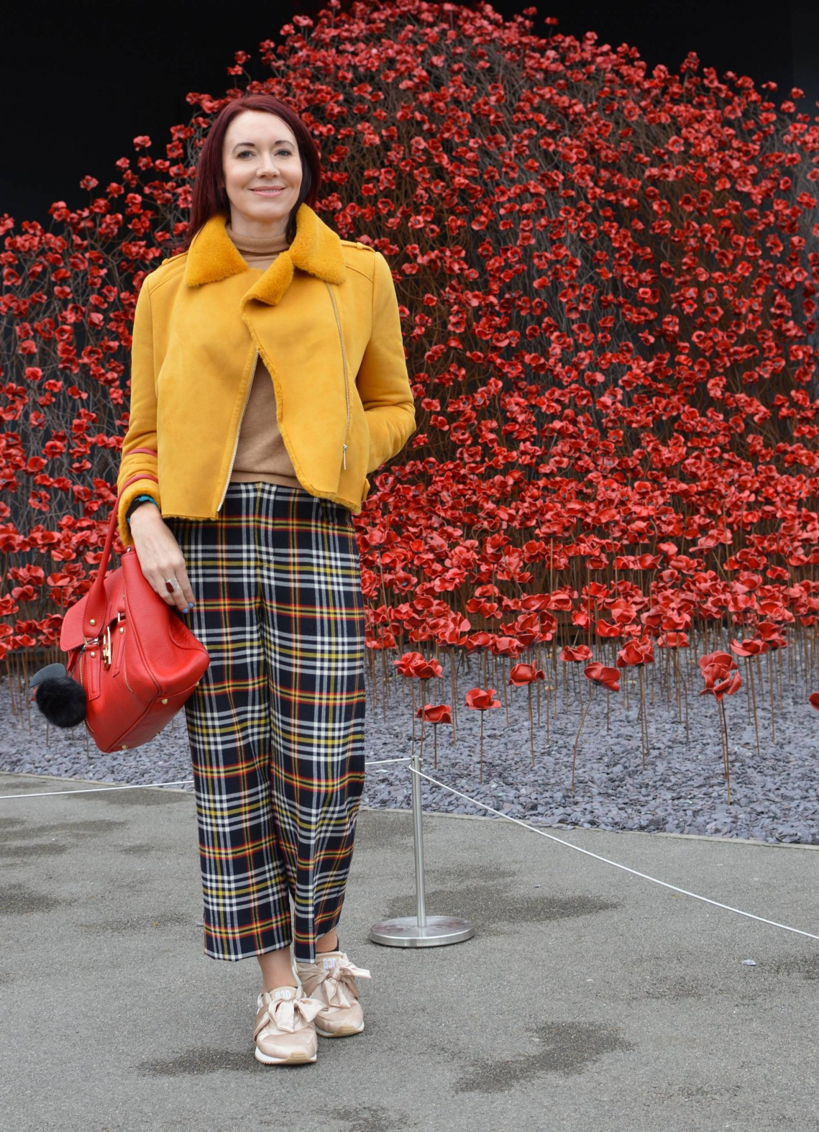 Mustard biker jacket and tartan trousers