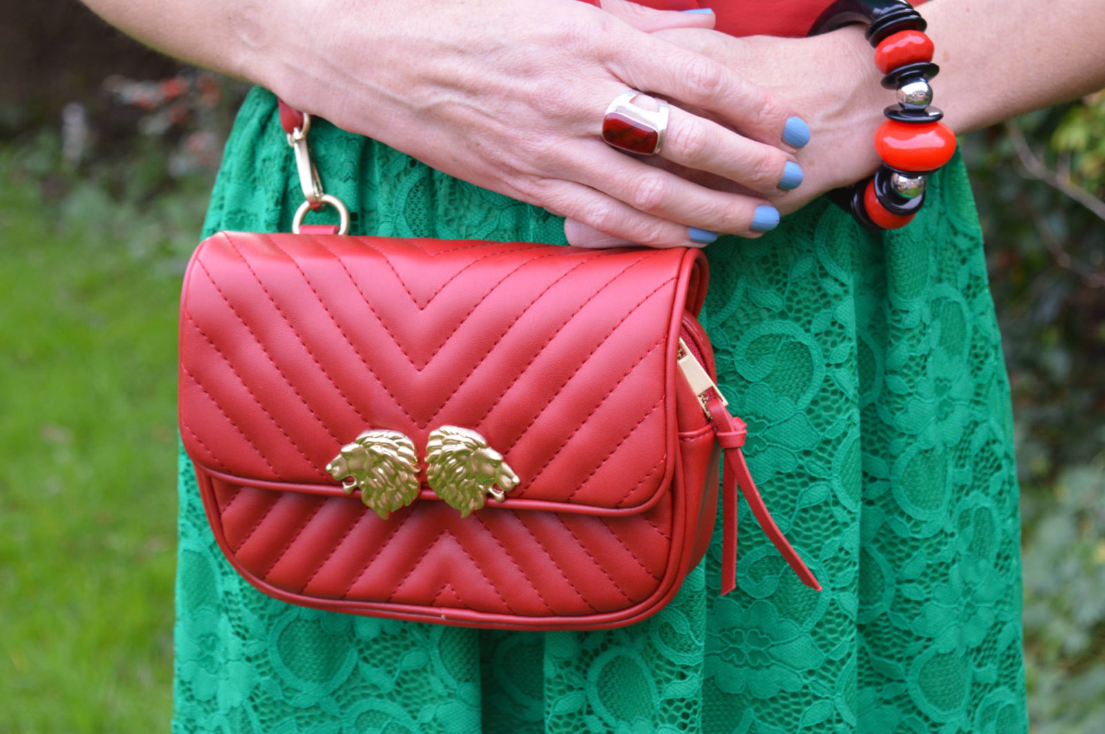 Green lace dress, Zara red multiway bag