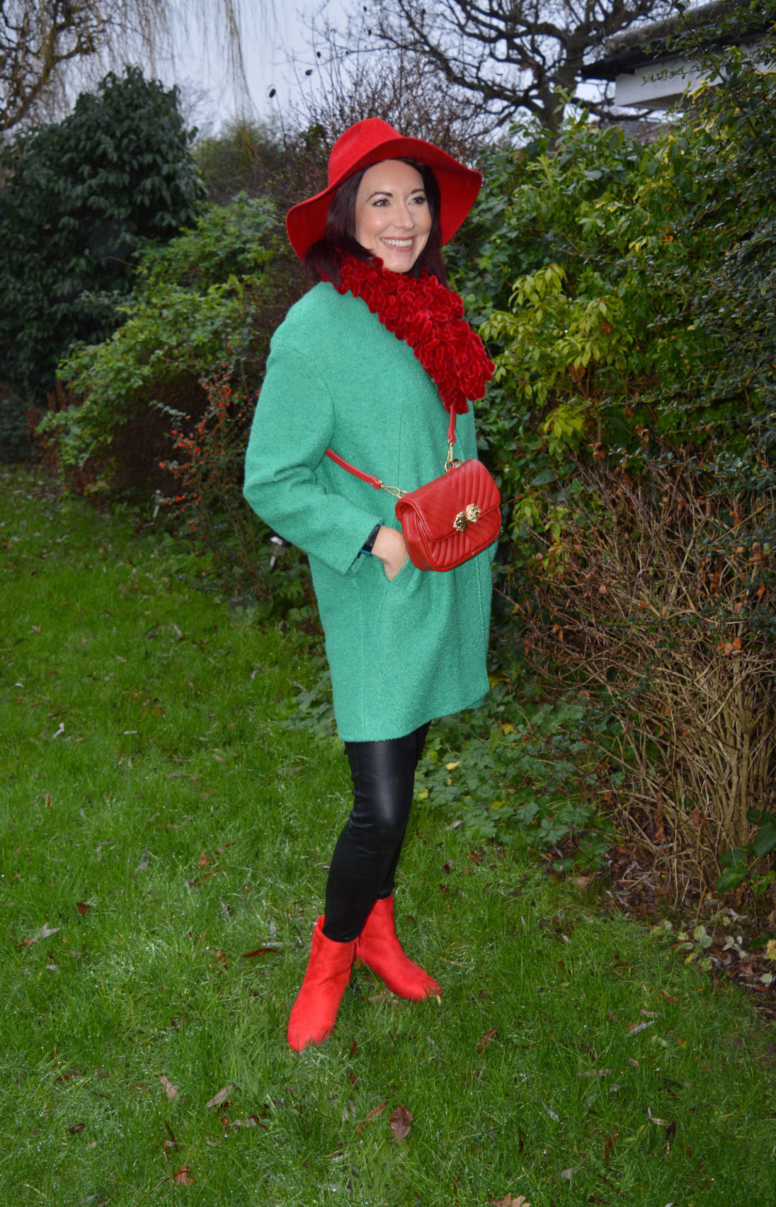 Bright green coat with red accessories Per Una green coat, Zara multiway bag