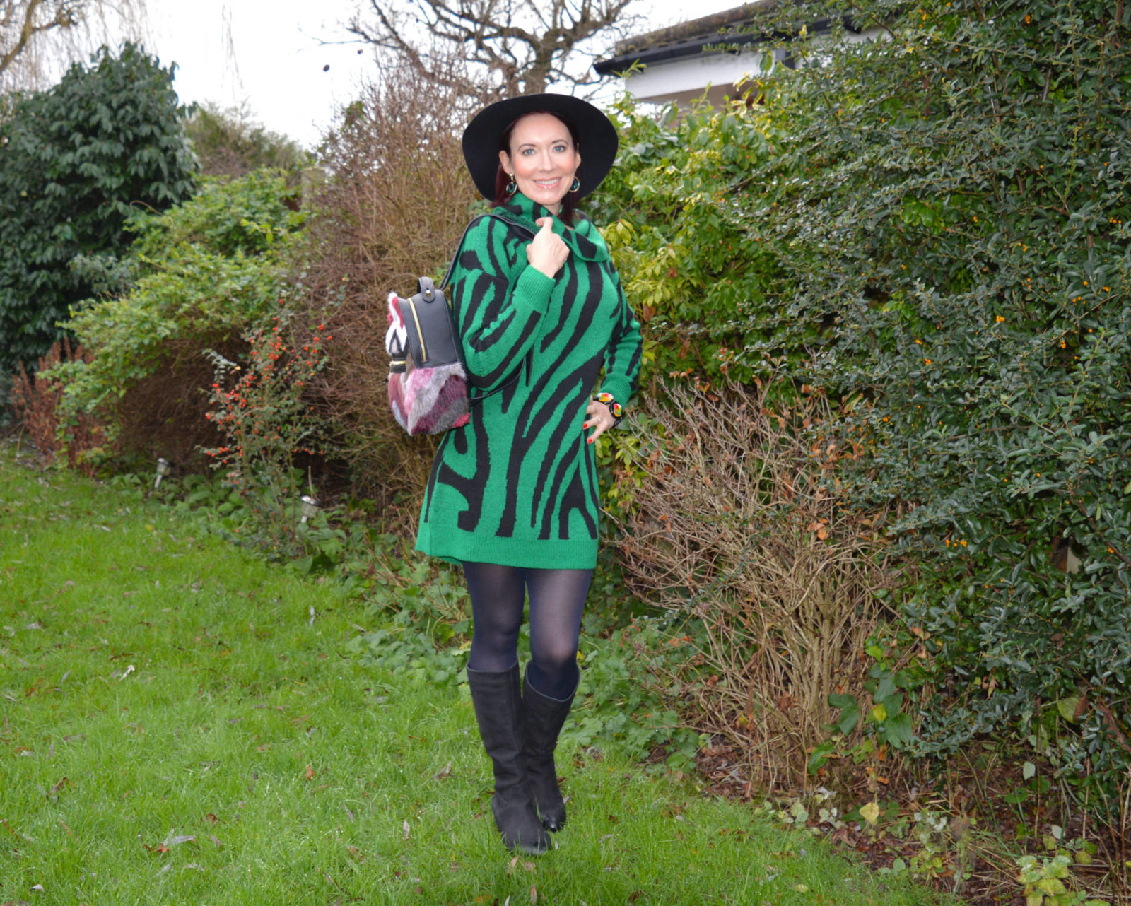 Bonmarche Green zebra print tunic jumper, faux fur backpack