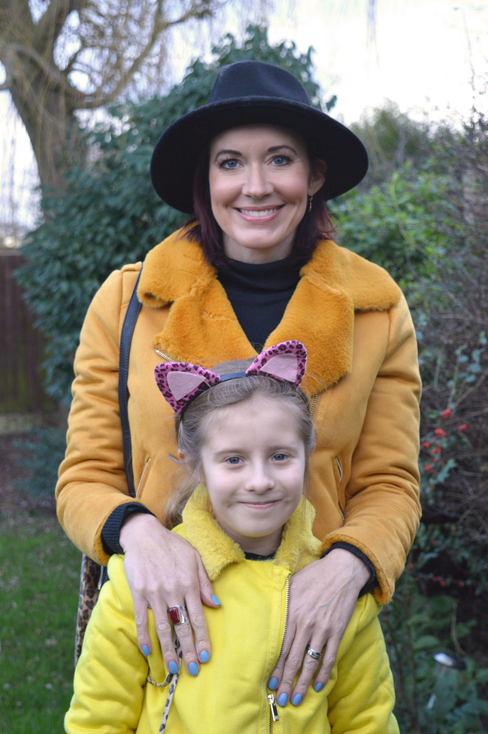 Matching yellow jackets, glitter trousers and biker boots