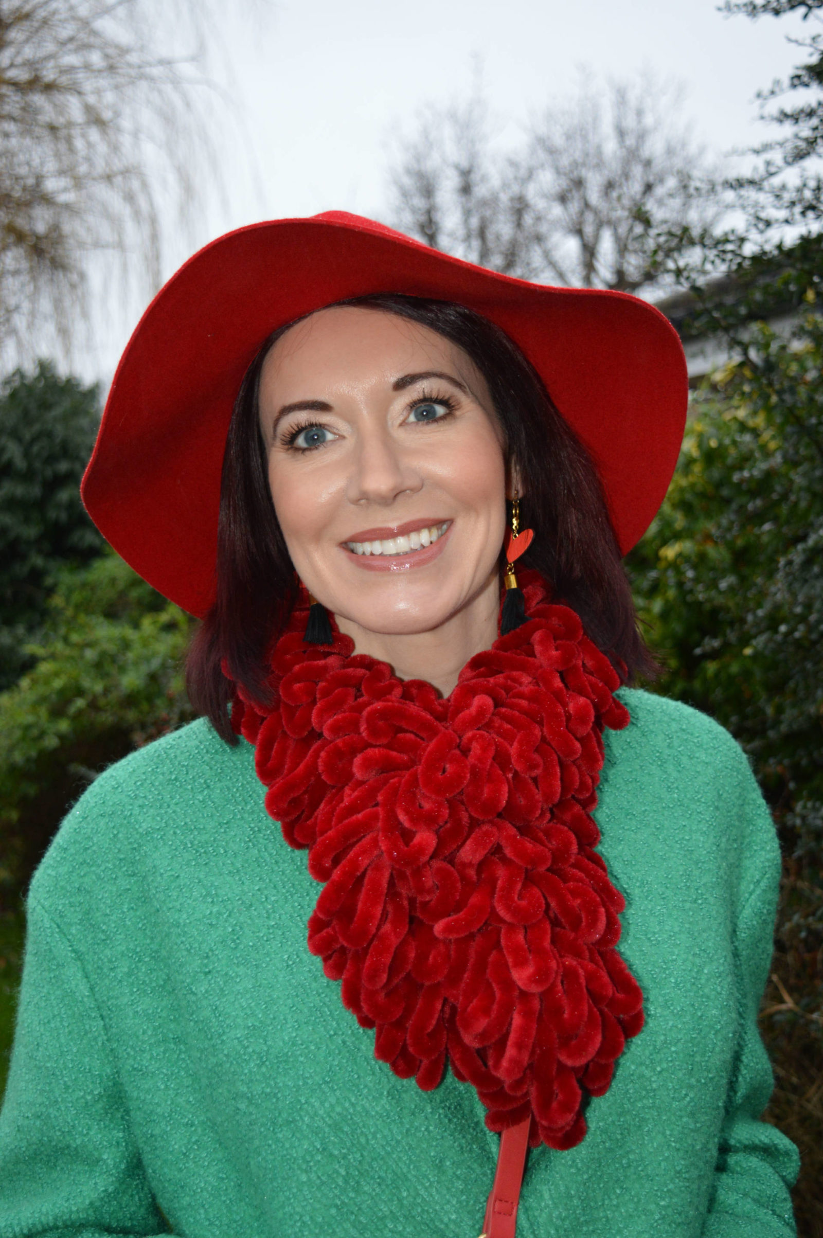 Bright green coat with red accessories Per Una green coat