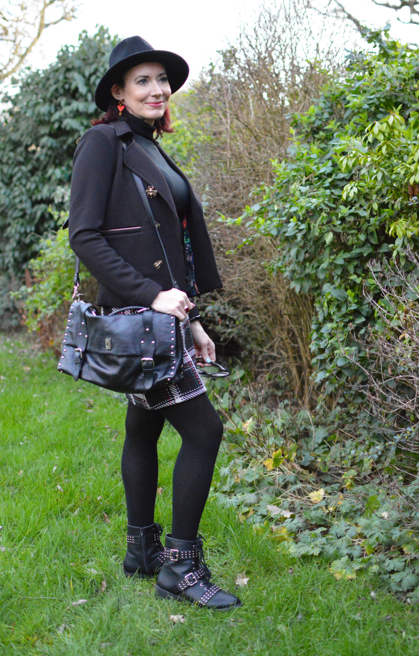 Check skirt and studded biker boots, Pom Amsterdam bugs jacket, Modalu studded satchel
