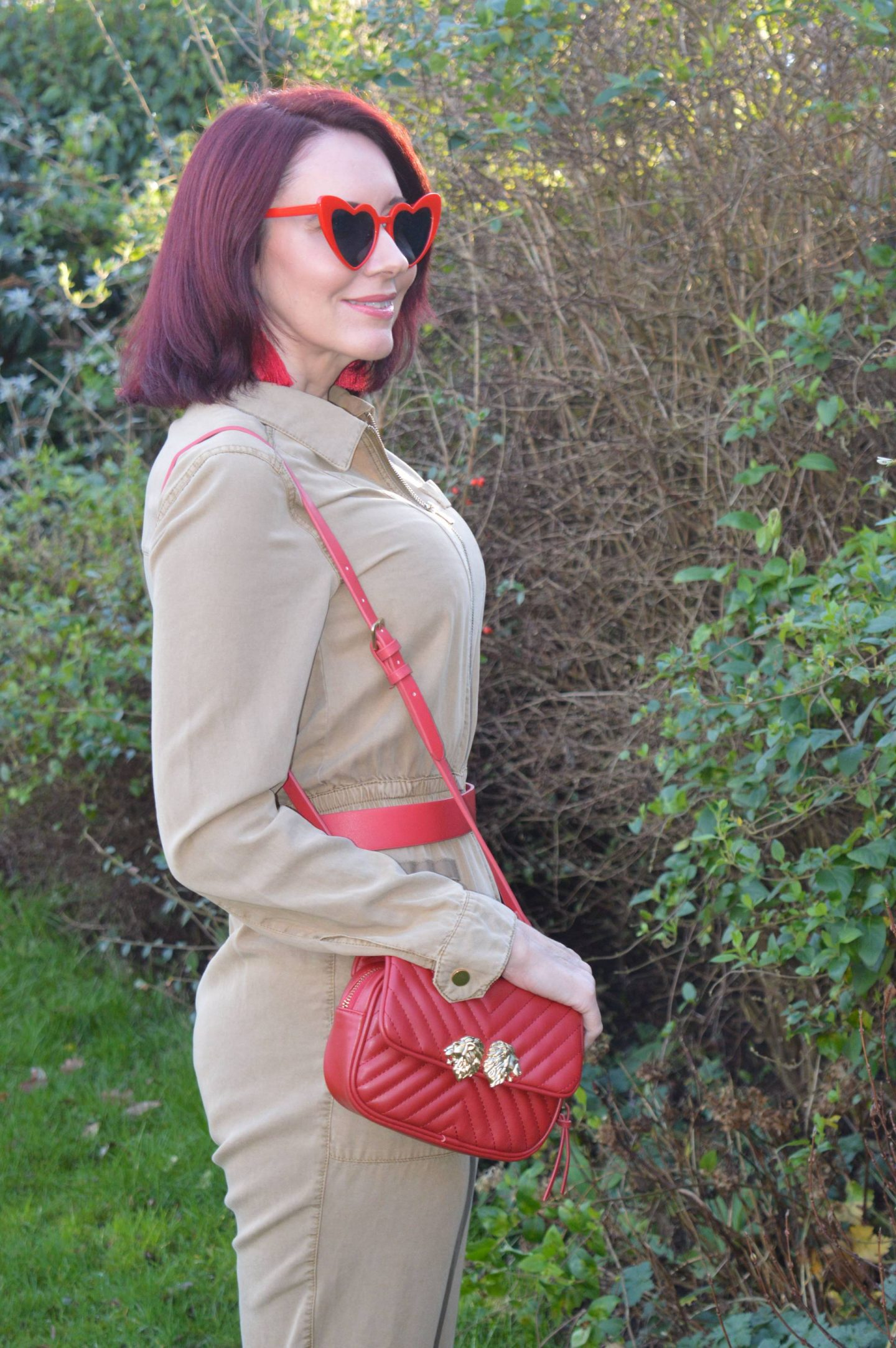 Styling a Utility Jumpsuit, River Island beige jumpsuit, Zara red multiway bag