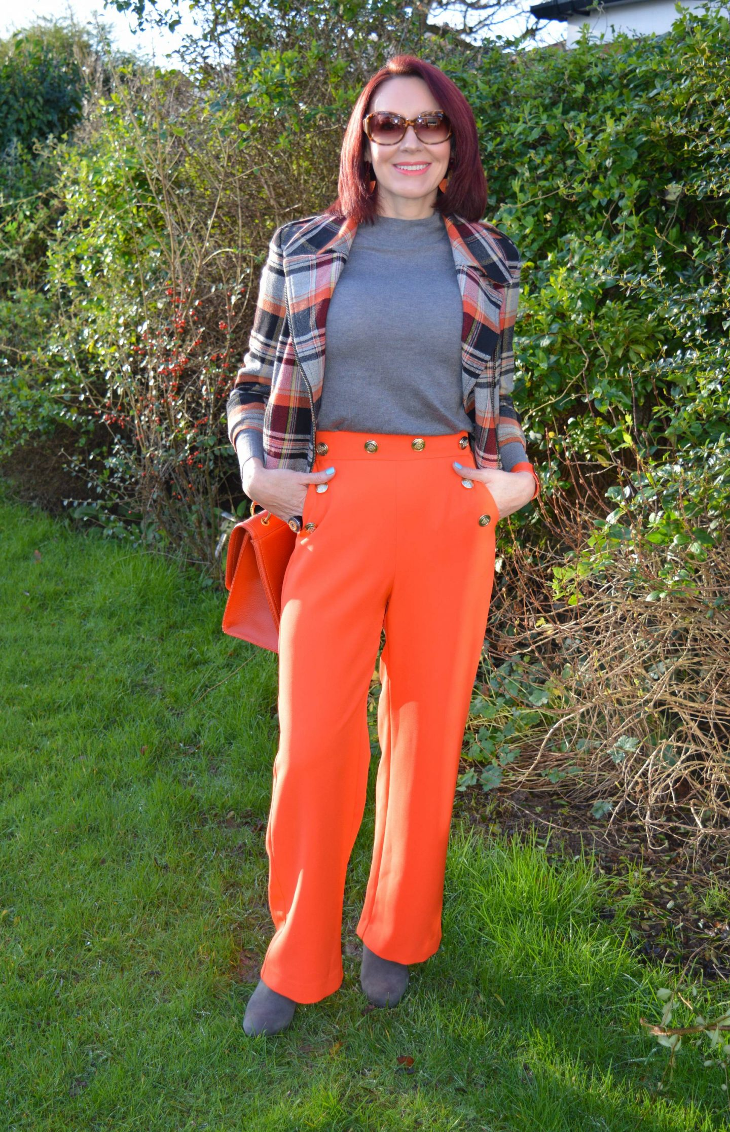 Bright Orange and Tartan, River Island orange trousers, French Connection tartan biker jacket