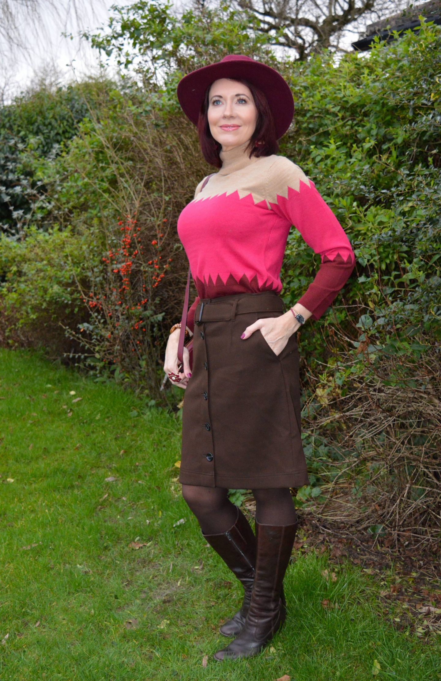 Marks & Spencer brwon button up skirt, camel and pink zig zag roll neck jumper