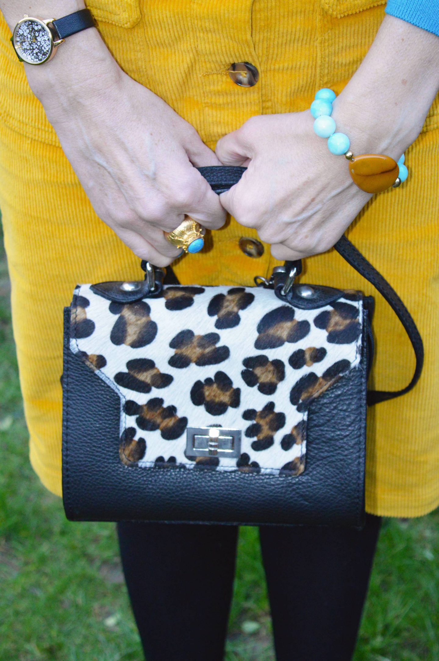 yellow cord skirt, leopard print bag