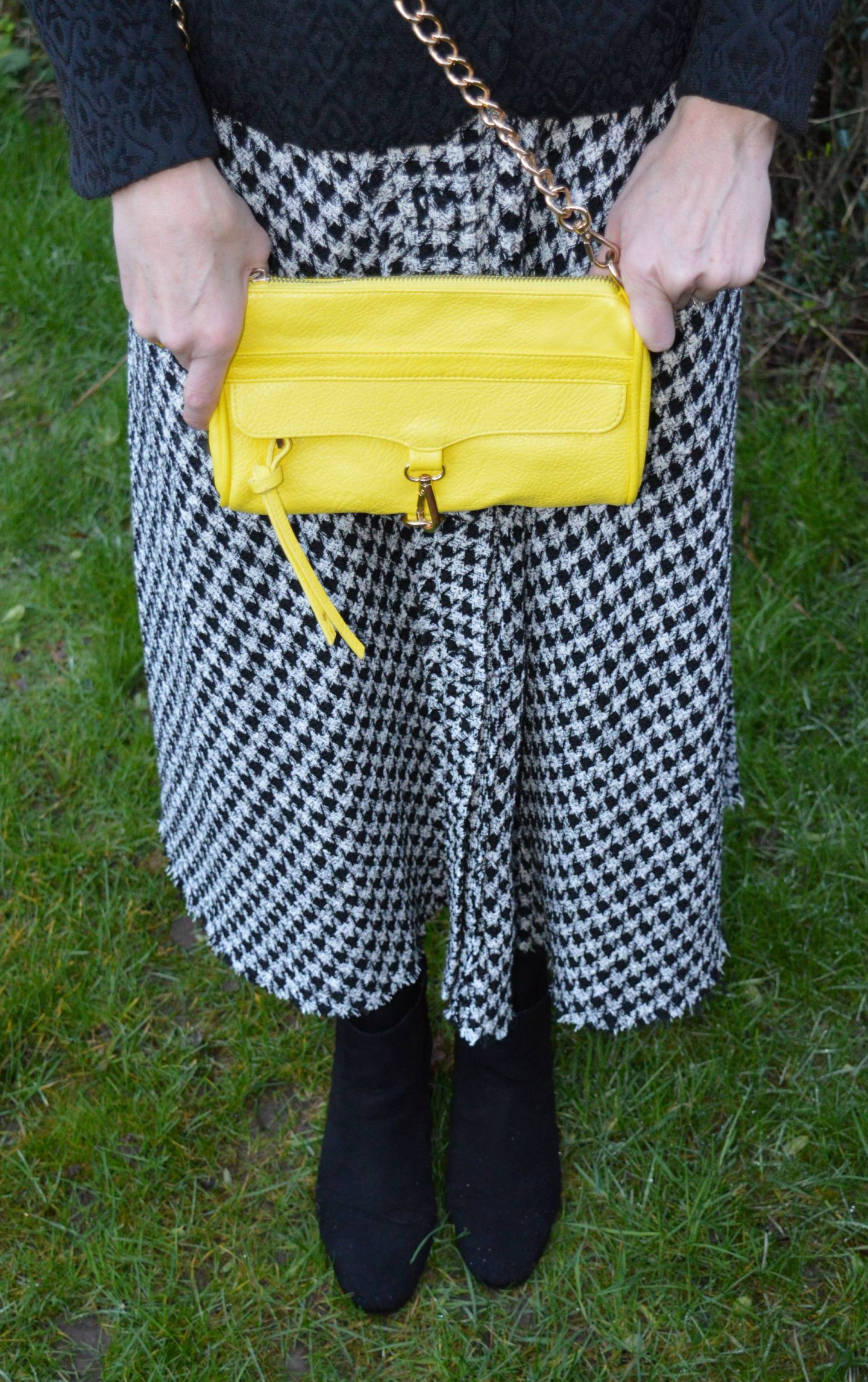 Zara black and white check skirt, bright yellow chain handle bag