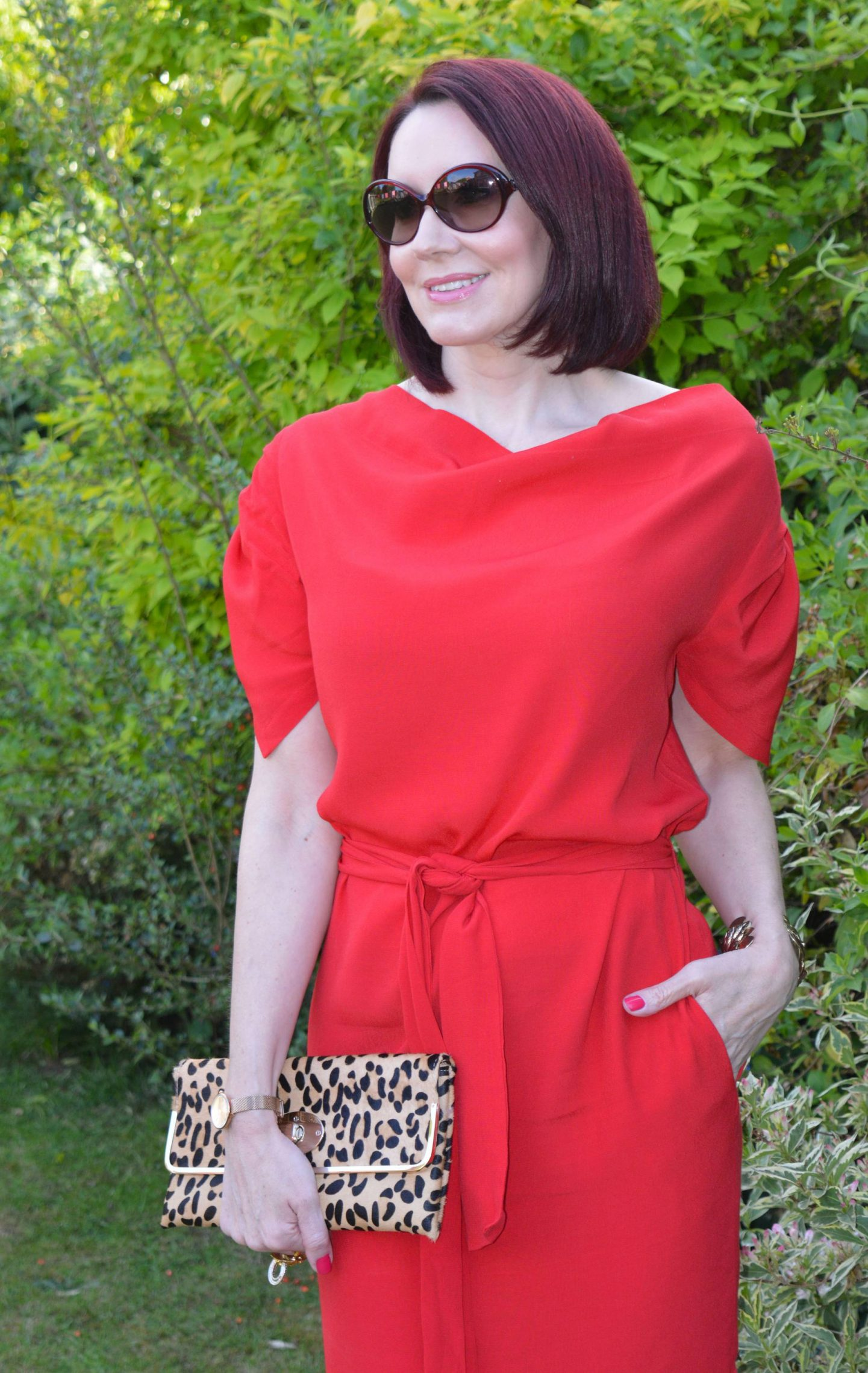 Red Anglomania belted dress, Dune leopard print clutch