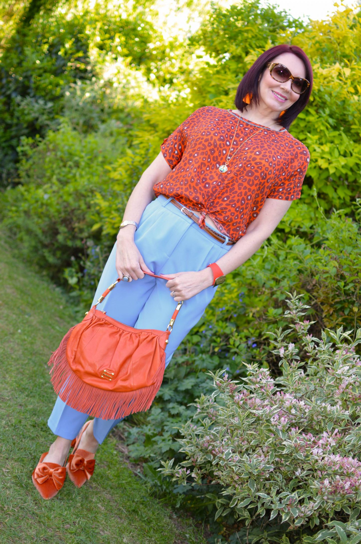 Blue and Bright Orange, Pale blue Asos peg leg trousers, Biba orange leopard print top, Asos orange velvet shoes