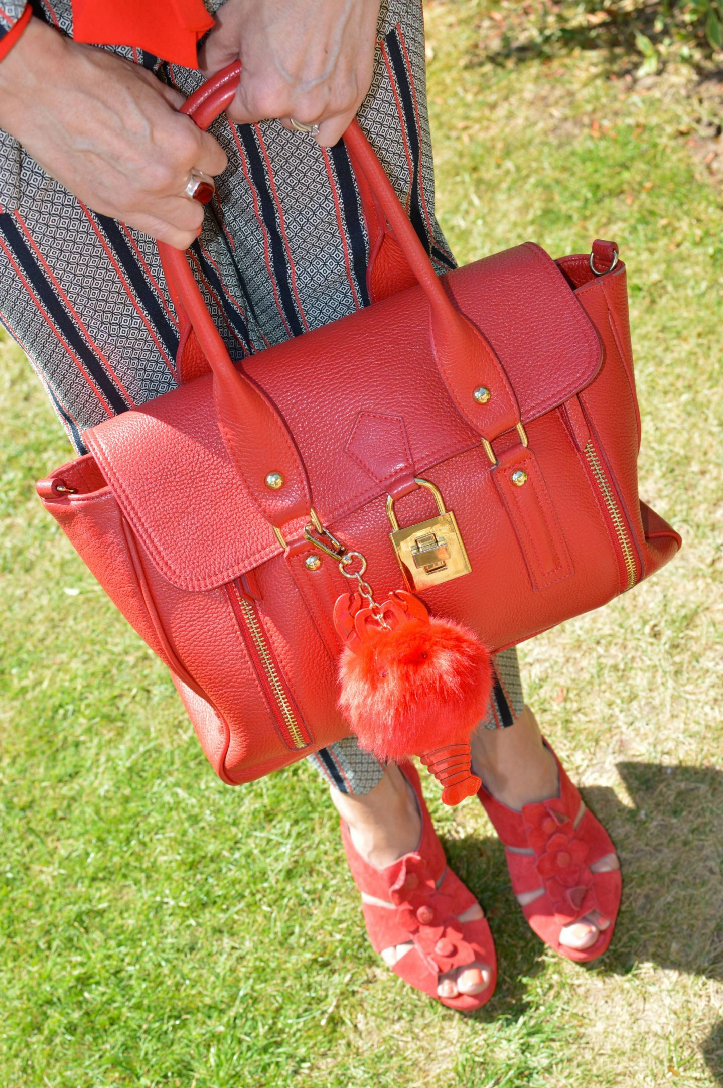 red Mila Blu bag, red Hush Puppies sandals