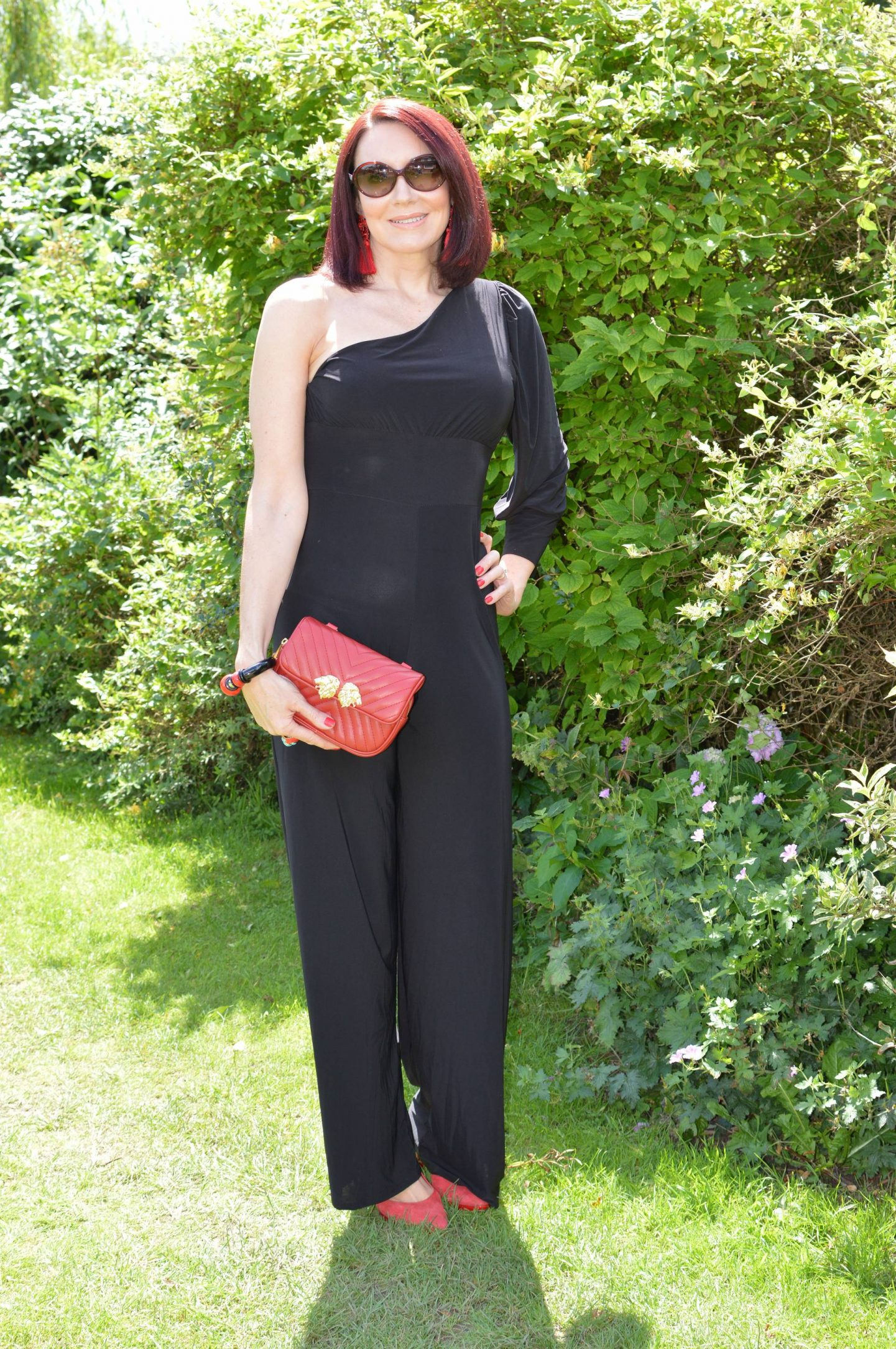Femme Luxe Black One Shoulder Jumpsuit With Red Accessories