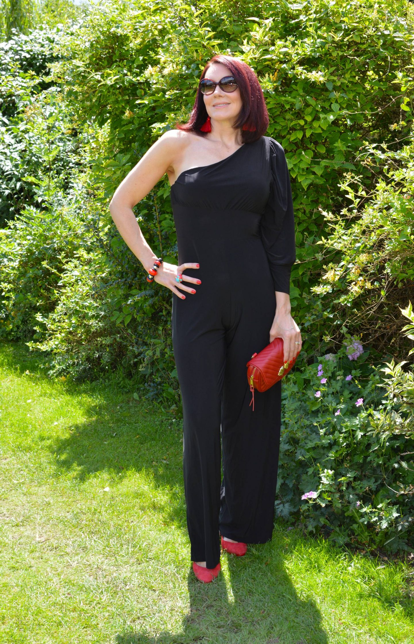 Femme Luxe slinky Black One Shoulder Jumpsuit With Red Accessories