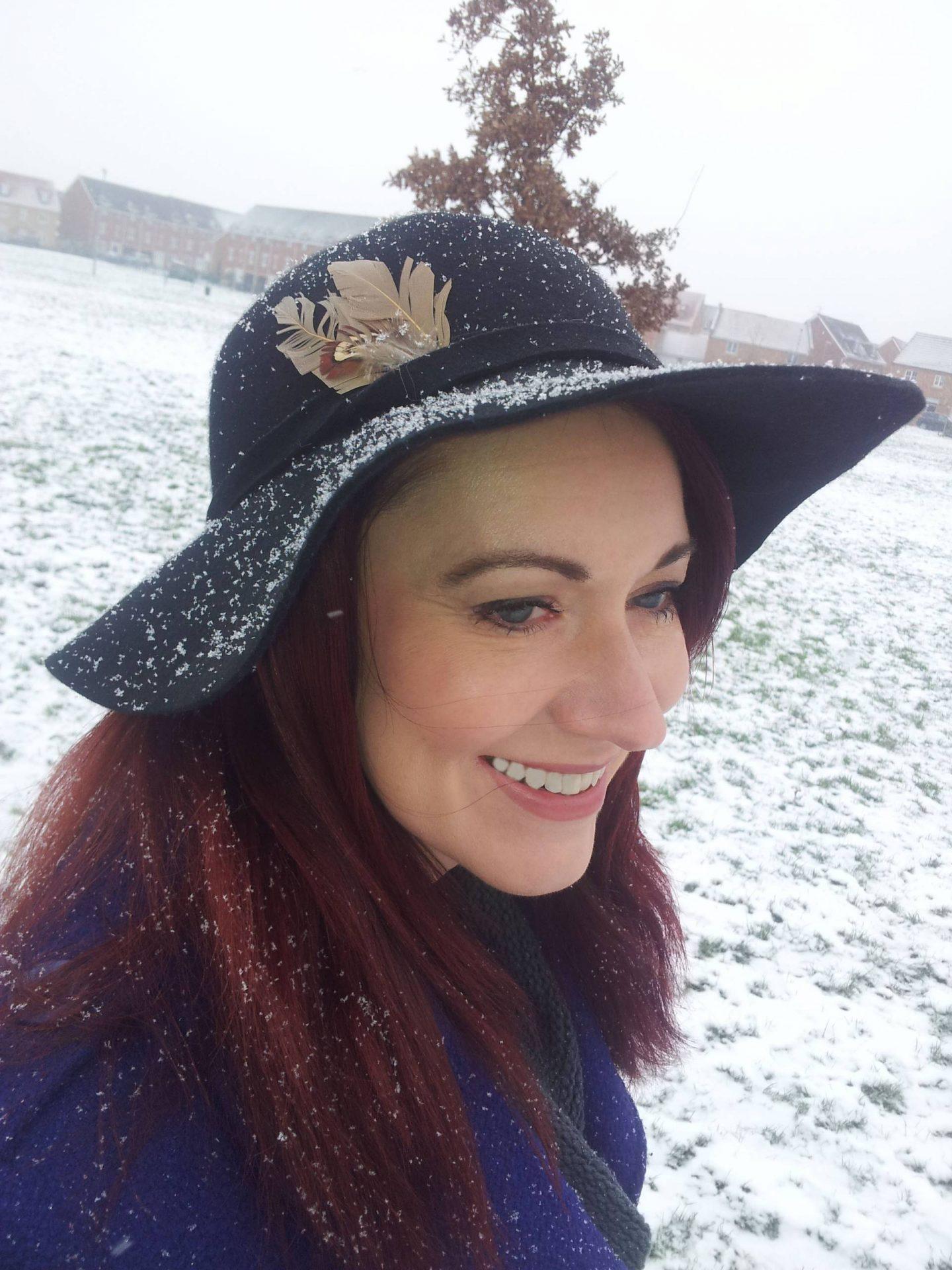 Winter Wonderland: Purple Coat and Wide Brim Hat